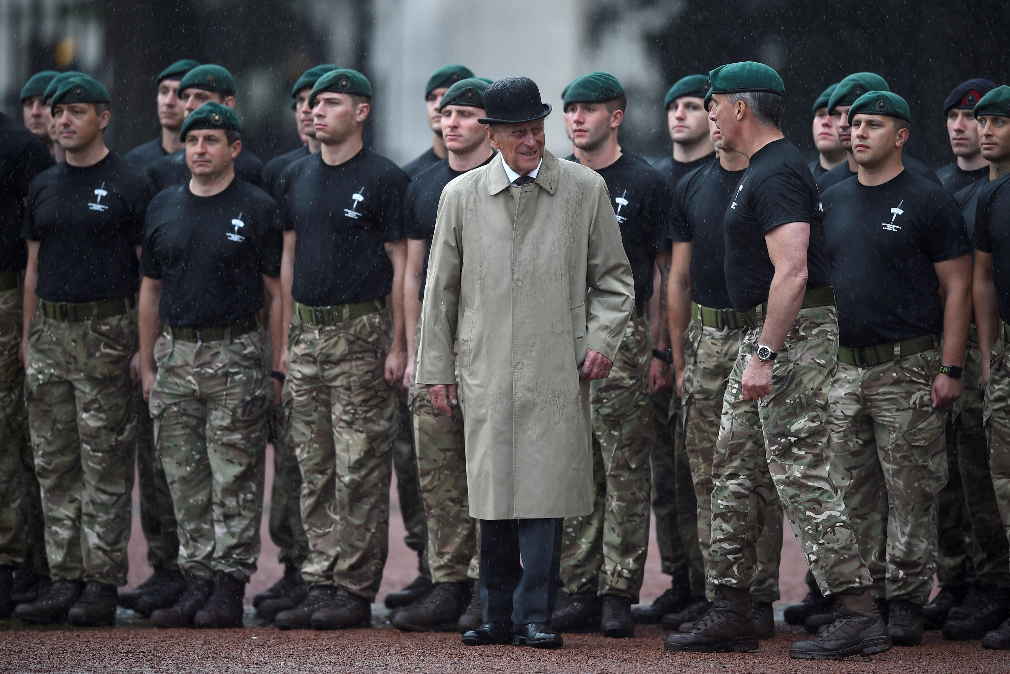 LONDON, ENGLAND - AUGUST 2: Prince Philip, Duke of Edinburgh (C) in his role as Captain General, Royal Marines, makes his final individual public engagement as he attends a parade to mark the finale of the 1664 Global Challenge, on the Buckingham Palace Forecourt on August 2, 2017 in London, England.