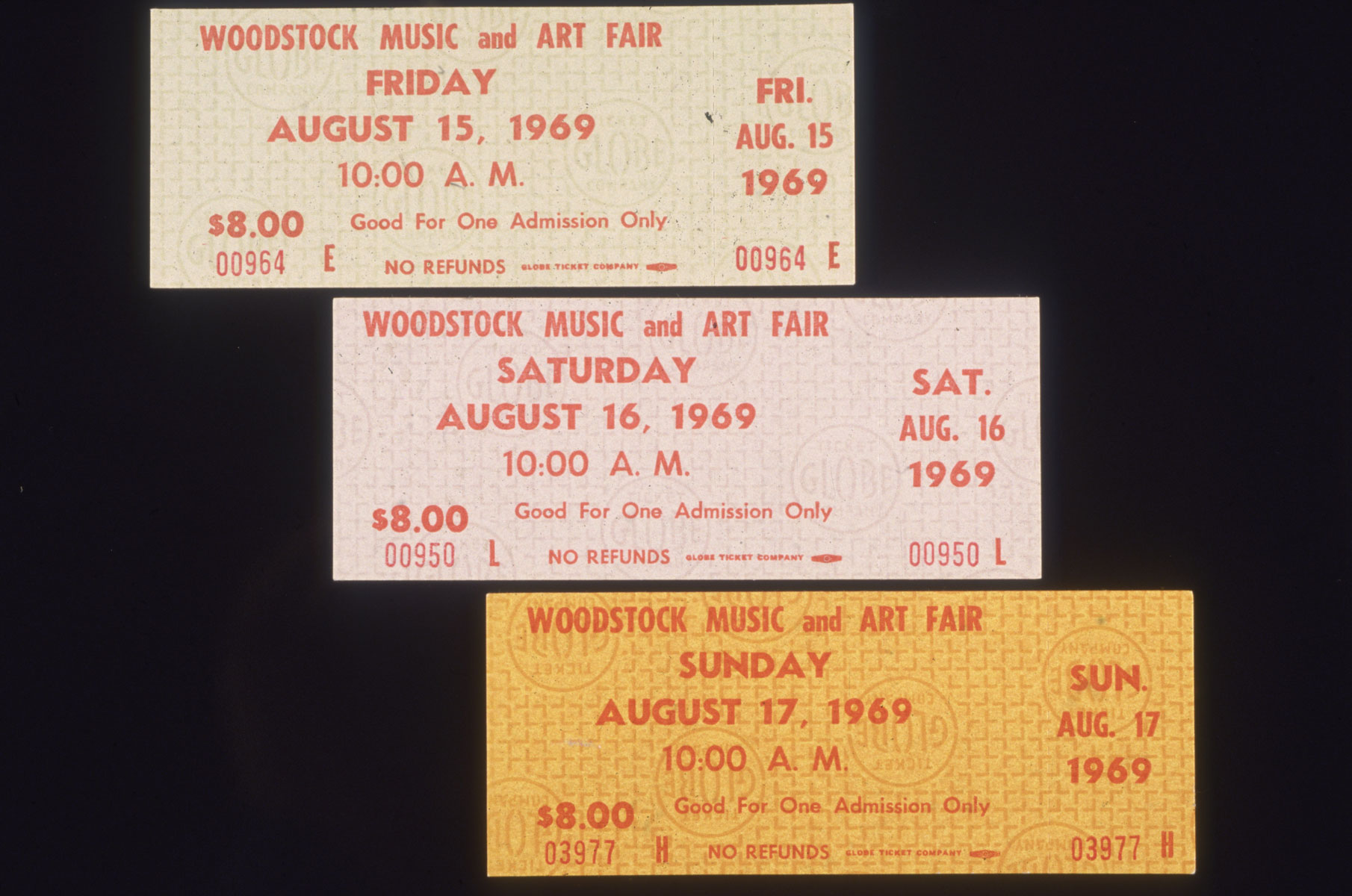 August 1969: Closeup still life of three single-day admission tickets for the Woodstock Music and Arts Fair in Bethel, New York.