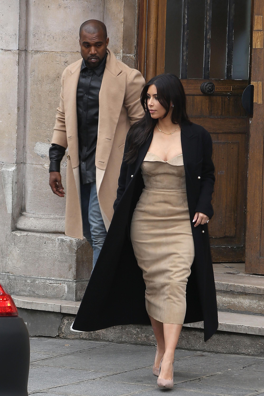 Kim Kardashian Sighting In ParisPARIS, FRANCE - MAY 21: Kim Kardashian and Kanye West leave the 'Maison Martin Margiela' showroom on May 21, 2014 in Paris, France. (Photo by Marc Piasecki/GC Images/Getty Images