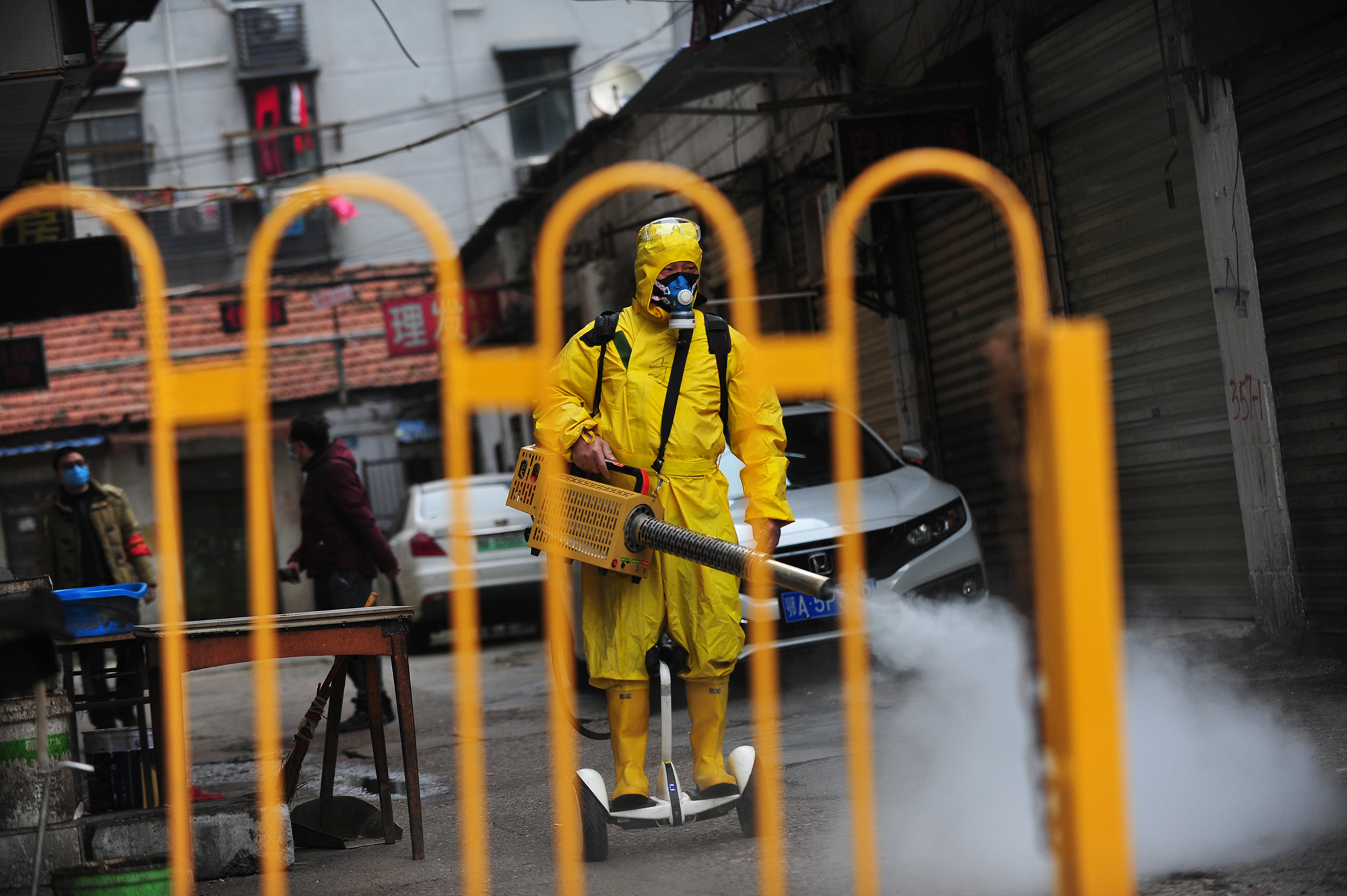 UHAN, CHINA - MARCH 11 2020: A volunteer on a personal transporter disinfects a community in Wuhan in central China's Hubei province Wednesday, March 11, 2020.- PHOTOGRAPH BY Feature China / Barcroft Studios / Future Publishing (Photo credit should read Feature China/Barcroft Media via Getty Images