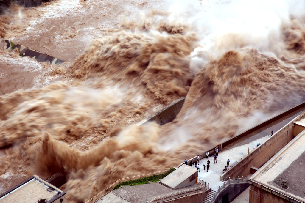 SANMENXIA, CHINA - AUGUST 28: People watch the water released by Sanmenxia Dam on August 28, 2019 in Sanmenxia, Henan Province of China. Sanmenxia Dam discharges water to prevent floods.