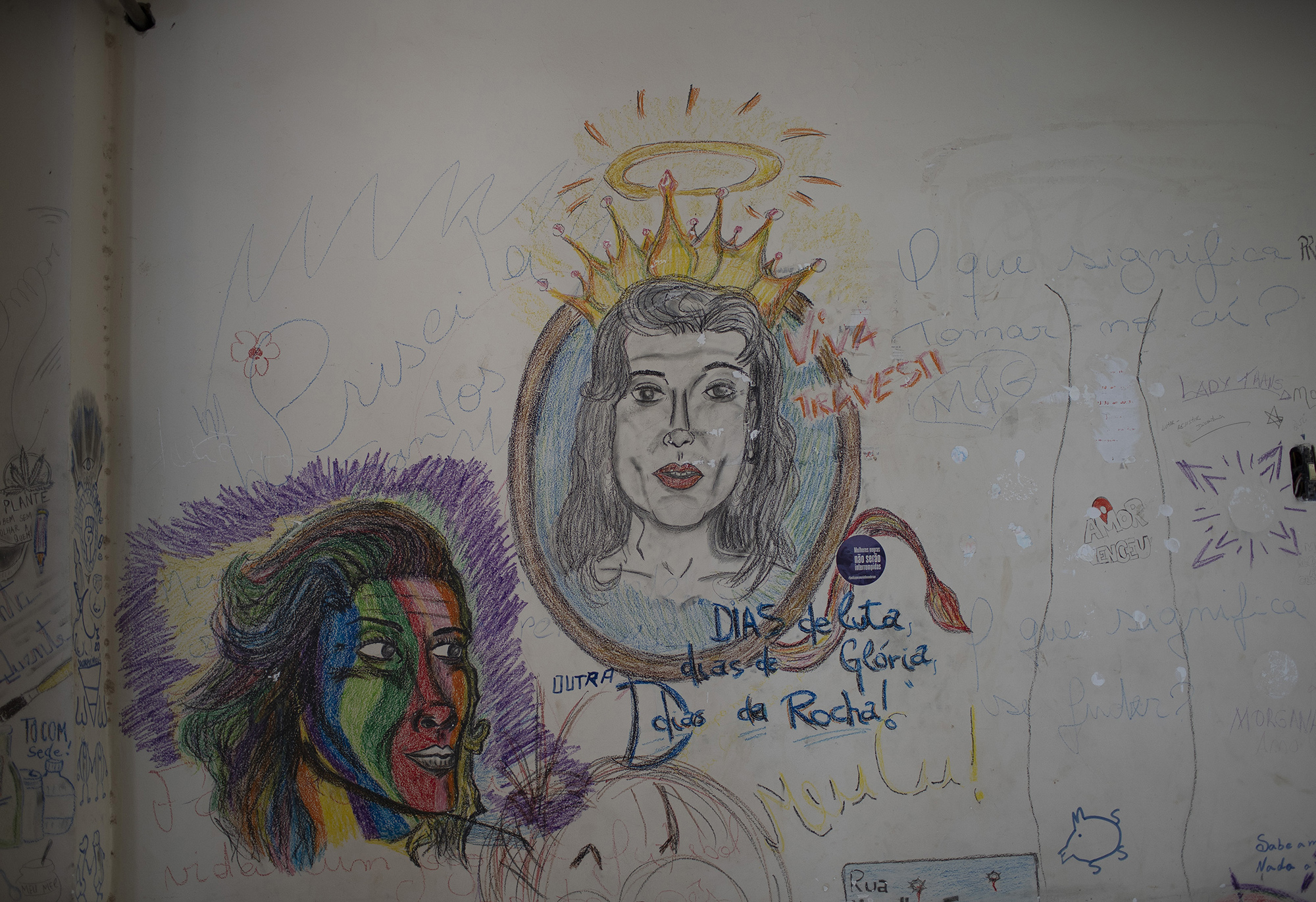 Drawings and messages honoring the transgender community decorate a wall of at the squat known as Casa Nem, occupied by members of the LGBTQ community who are in self-quarantine as a protective measure against the new coronavirus, in Rio de Janeiro, Brazil, Friday, May 29, 2020. New residents during the pandemic have to isolate on one of the building's floors for 15 days to ensure they don't develop symptoms before fully joining the community.