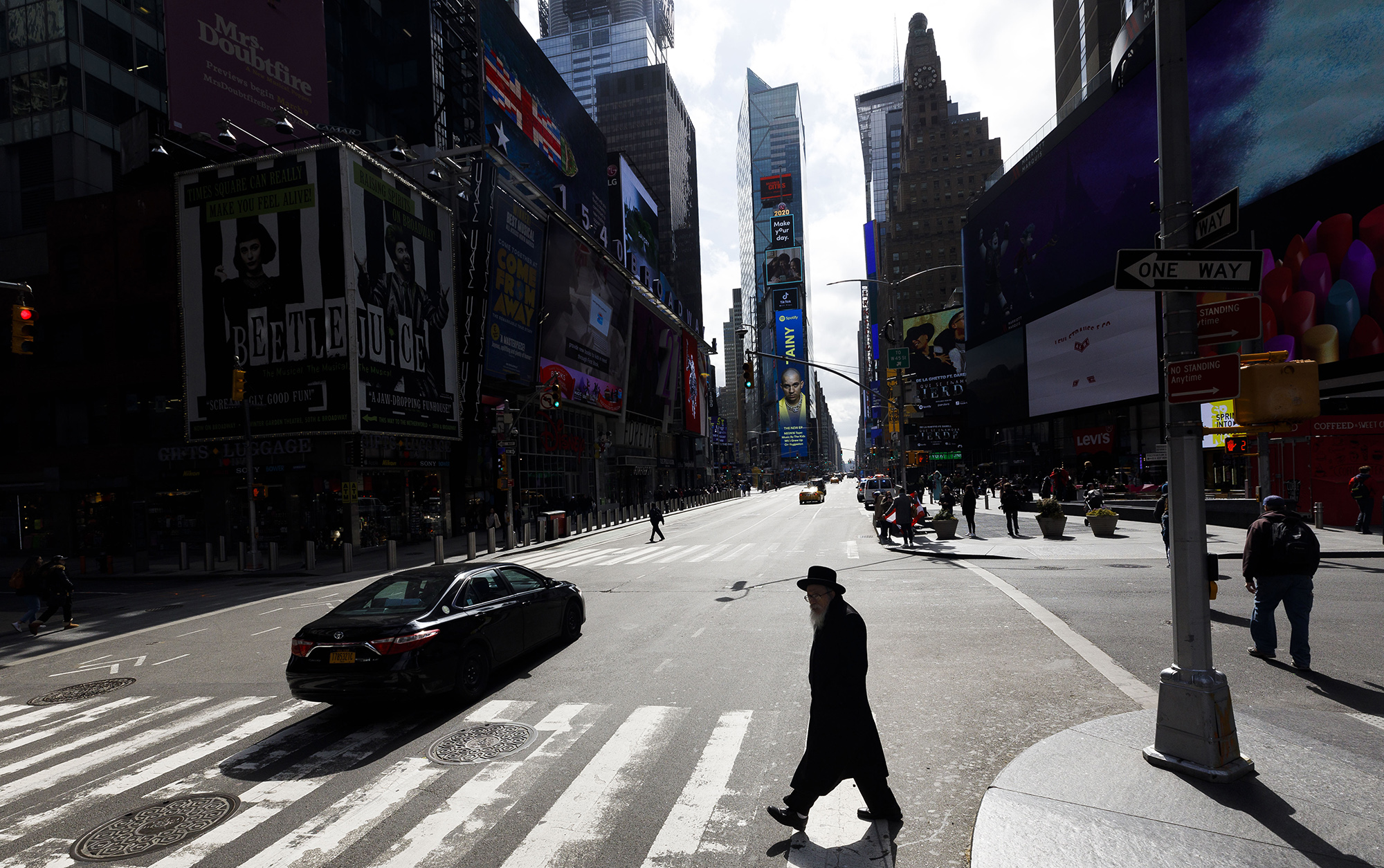 A person walks through a quiet Times Square in New York, New York, USA, 16 March 2020. New York, as with most cities around the United States and the world, are trying to mitigate the spread of the coronavirus and all restaurants and bars will be forced to close as of tonight. EPA-EFE/JUSTIN LANE