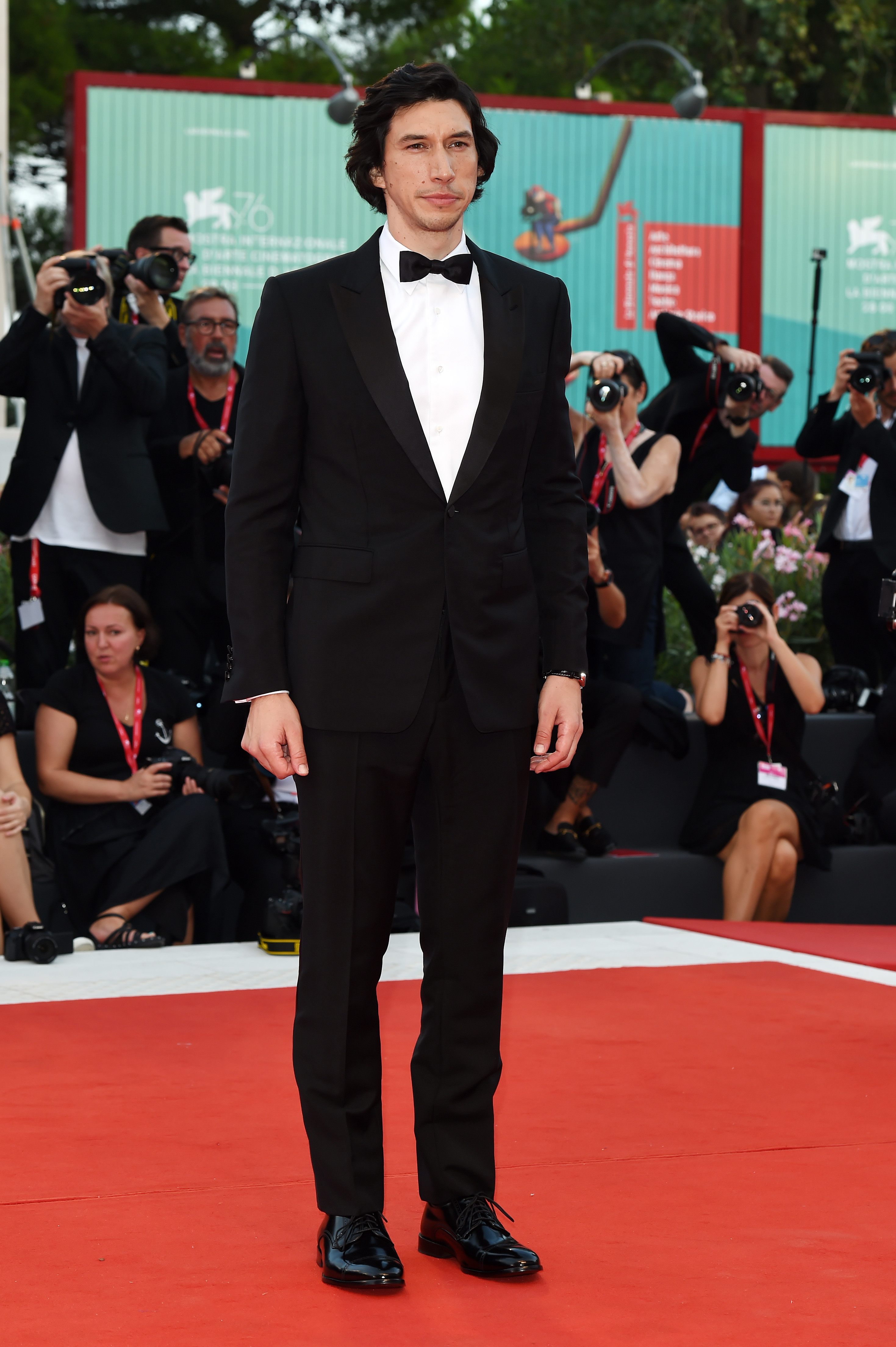 VENICE, ITALY - AUGUST 29: Actor Adam Driver walks the red carpet ahead of the