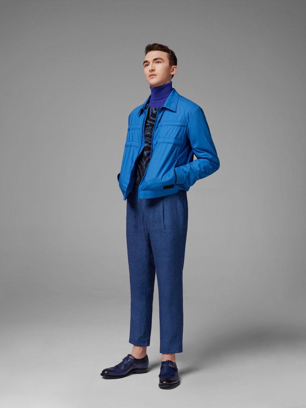 Водолазка, Mr. P; пуловер, Tiger of Sweden; бомбер, Moncler Genius x Craig Green; брюки, Etro; ботинки, Grenson