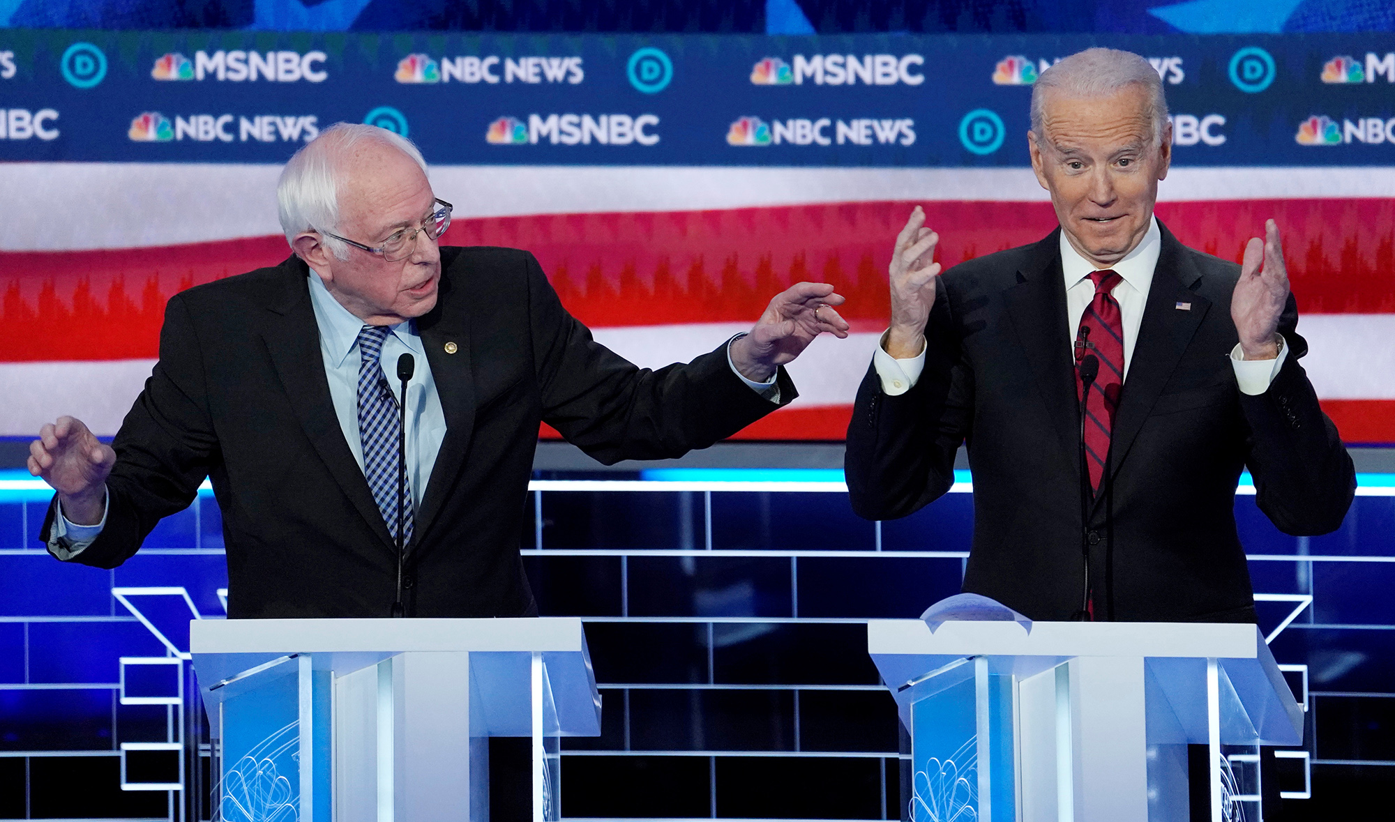 DATE IMPORTED:February 20, 2020Senator Bernie Sanders speaks as former Vice President Joe Biden reacts during the ninth Democratic 2020 U.S. Presidential candidates debate at the Paris Theater in Las Vegas Nevada, U.S., February 19, 2020. REUTERS/Mike Blake TPX IMAGES OF THE DAY
