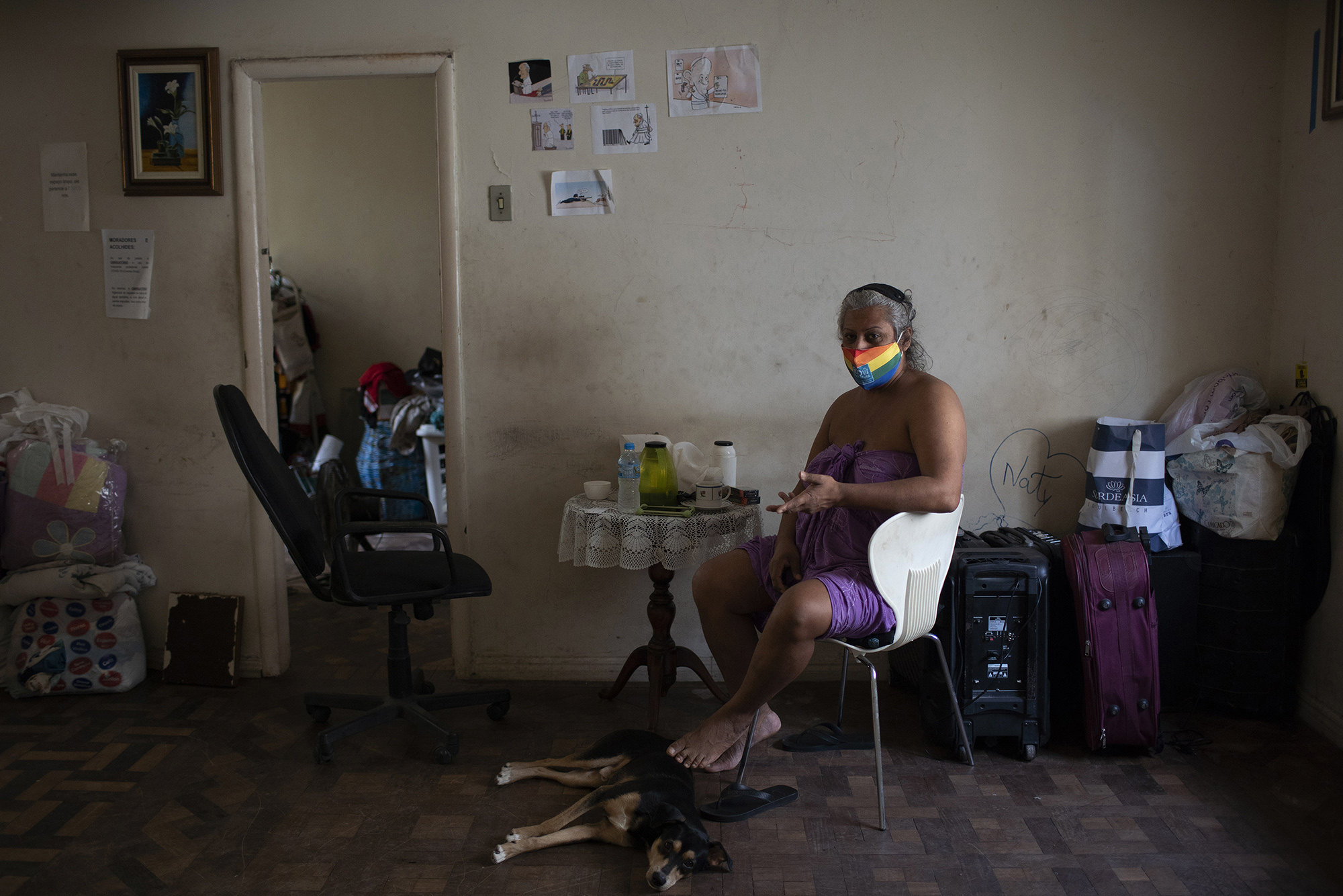 Indianara Siqueira poses for a photo in her room at the squat known as Casa Nem, occupied by members of the LGBTQ community who are in self-quarantine as a protective measure against the new coronavirus, in Rio de Janeiro, Brazil, Friday, May 22, 2020.