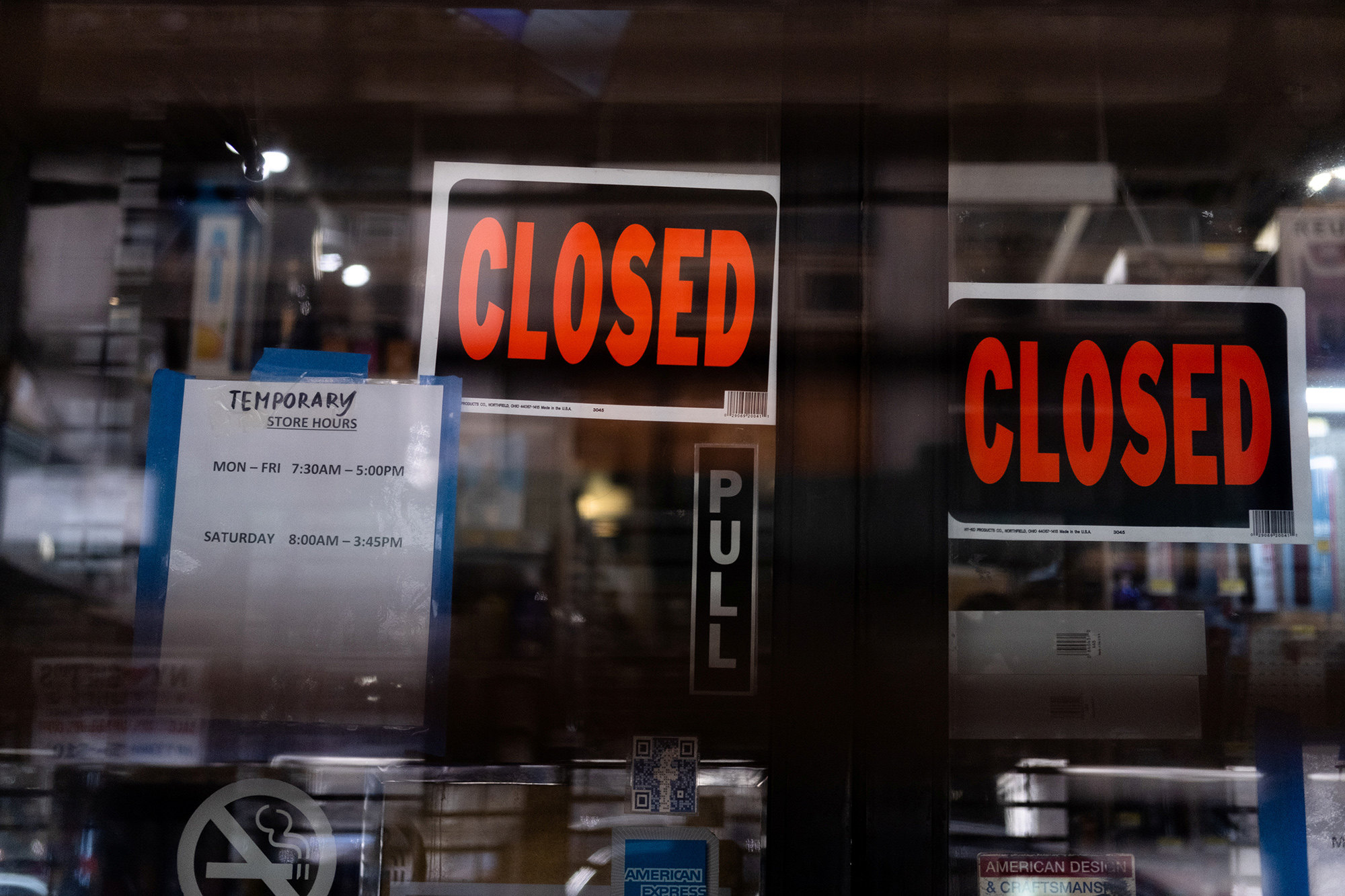 emporary closed signage is seen at a store in Manhattan borough following the outbreak of coronavirus disease (COVID-19), in New York City, U.S., March 15, 2020. REUTERS/Jeenah Moon