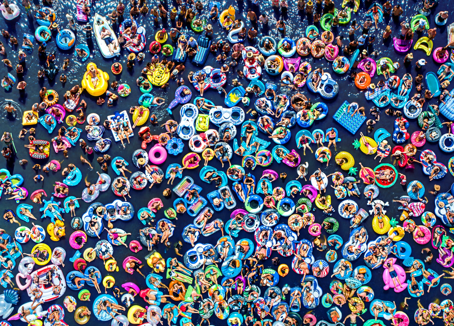 Floating People | People CommendedPeople in inner-tubes attend a concert on a floating stagePhotograph: Raf Willems/Drone Photography Awards 2021