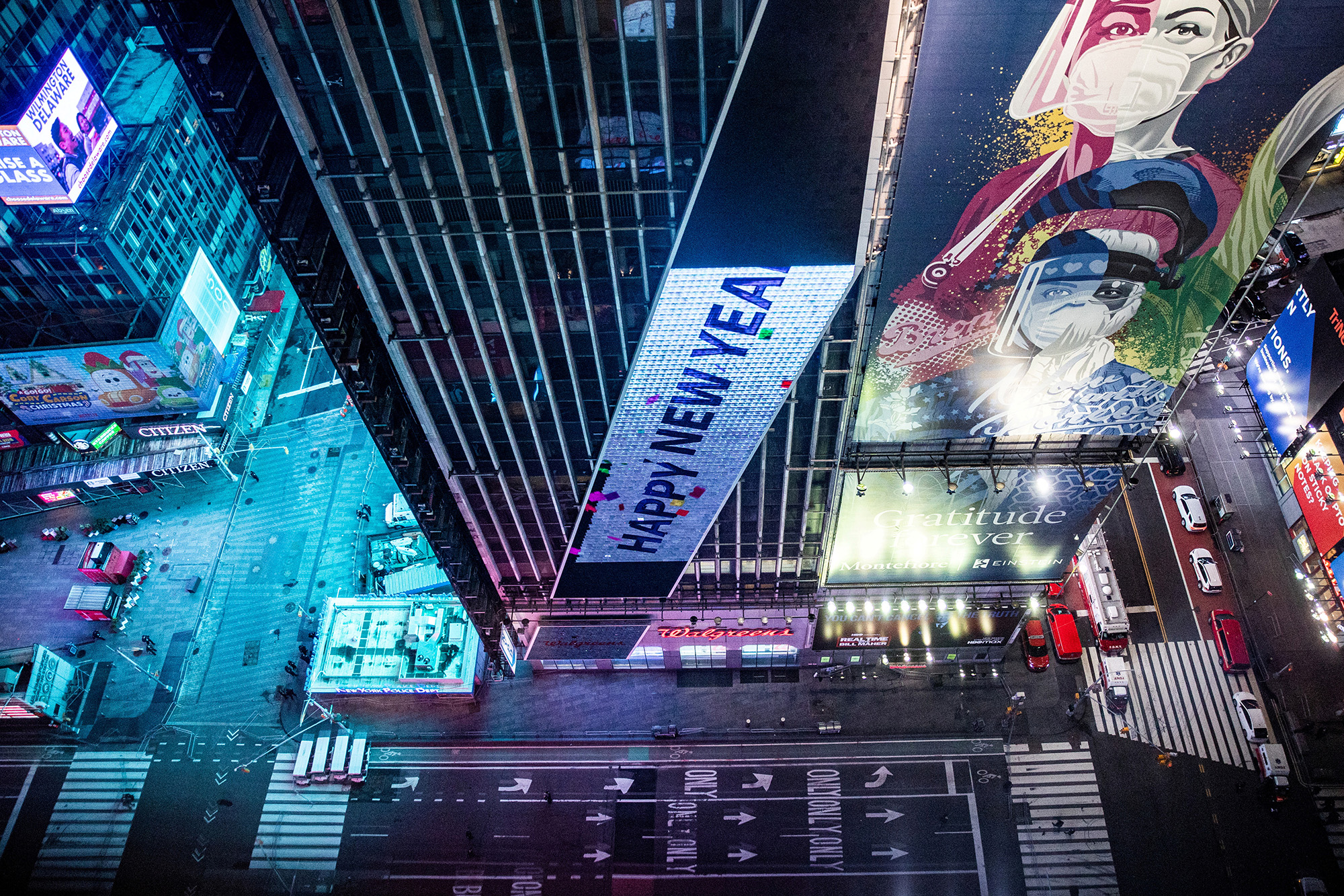 An empty street is seen in Times Square during the virtual New Year's Eve event following the outbreak of the coronavirus disease (COVID-19) in the Manhattan borough of New York City, New York, U.S., December 31, 2020. REUTERS/Jeenah Moon