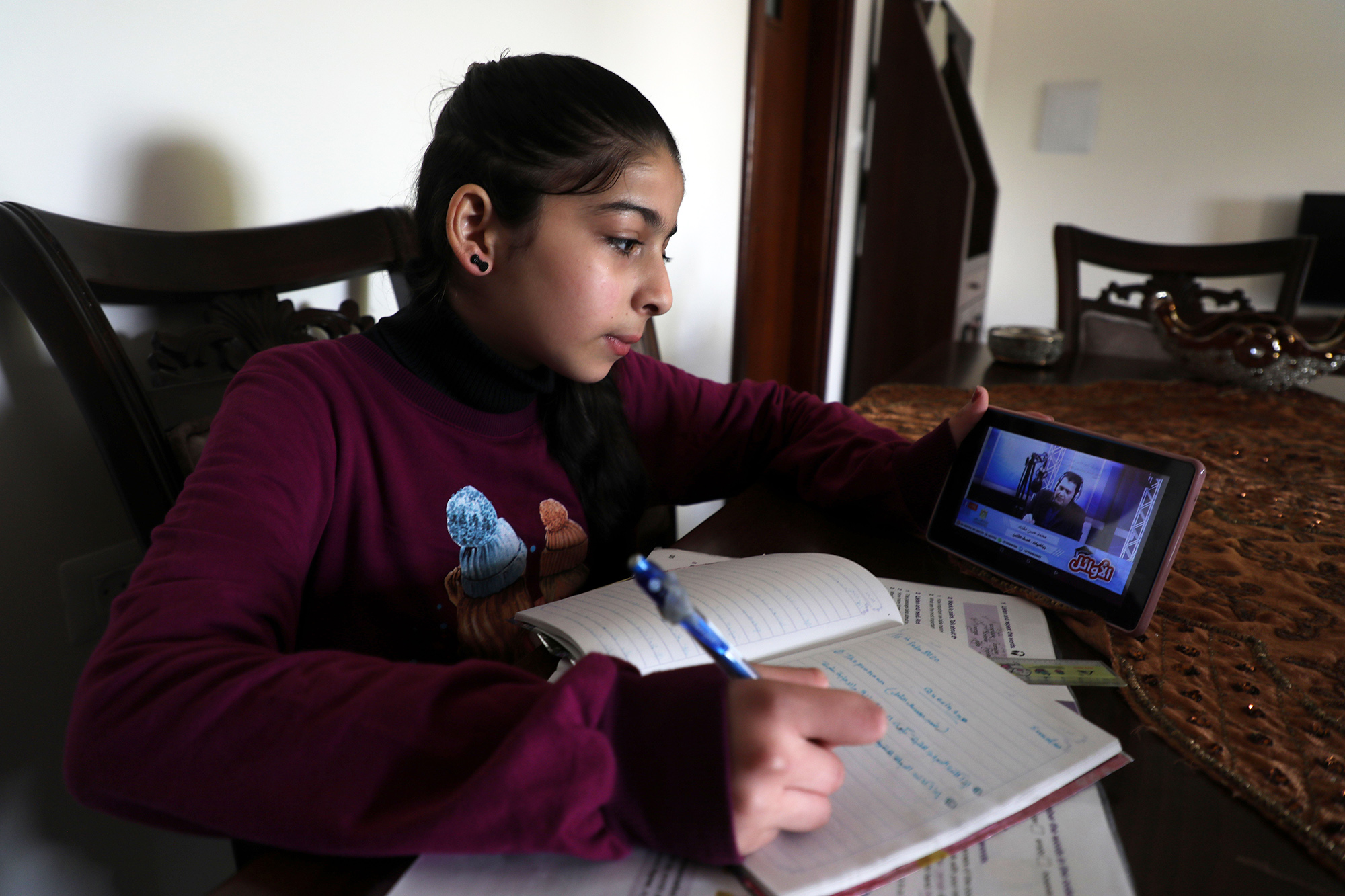 Palestinian student following up an electronic lesson on the Education radio, during school students vacation as a preventive measure amid fears of the spread of the novel coronavirus, in Gaza city, on March 15, 2020. (Photo by Majdi Fathi/NurPhoto via Getty Images)