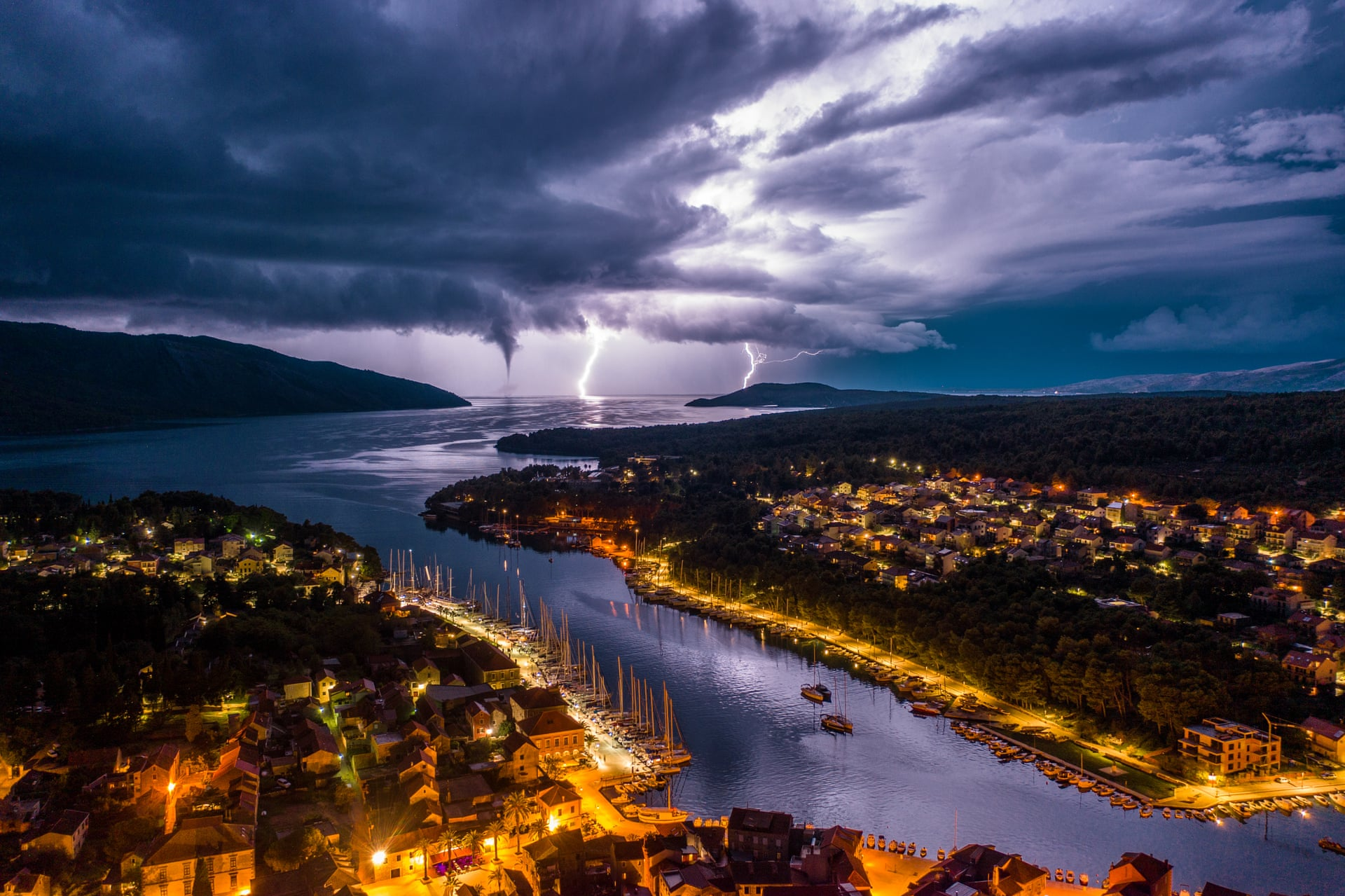Wild Night in the Adriatic| Nature CommendedStari Grad, on Hvar Island, with fork lightning and a waterspout on the open seaPhotograph: Miroslav Zadravec/Drone Photography Awards 2021
