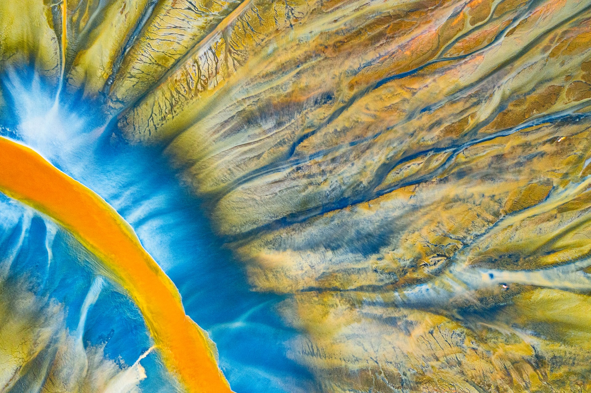 Poisoned River | Abstract WinnerA detailed photograph of a stream filled with poison. 'Poisoned Beauty' is a personal project that tells the story of the natural disaster in the Apuseni Mountains in Transylvania, which was a result of chemical waste generated by copper and gold mining, but in a beautifully abstract wayPhotograph: Gheorghe Popa/Drone Photography Awards 2021