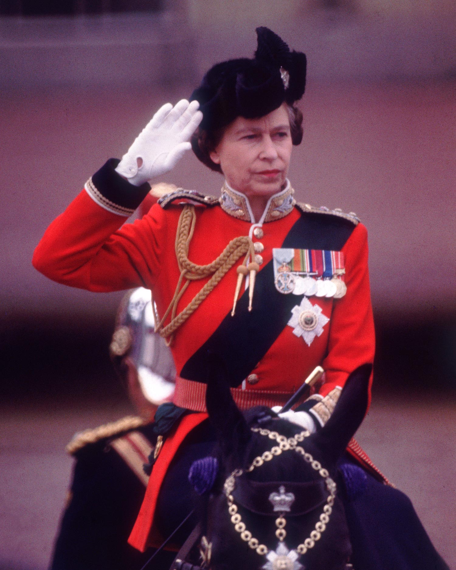 1979: Queen Elizabeth II takes the salute during the Trooping the Colour ceremony in London. (Photo by Keystone/Getty Images)