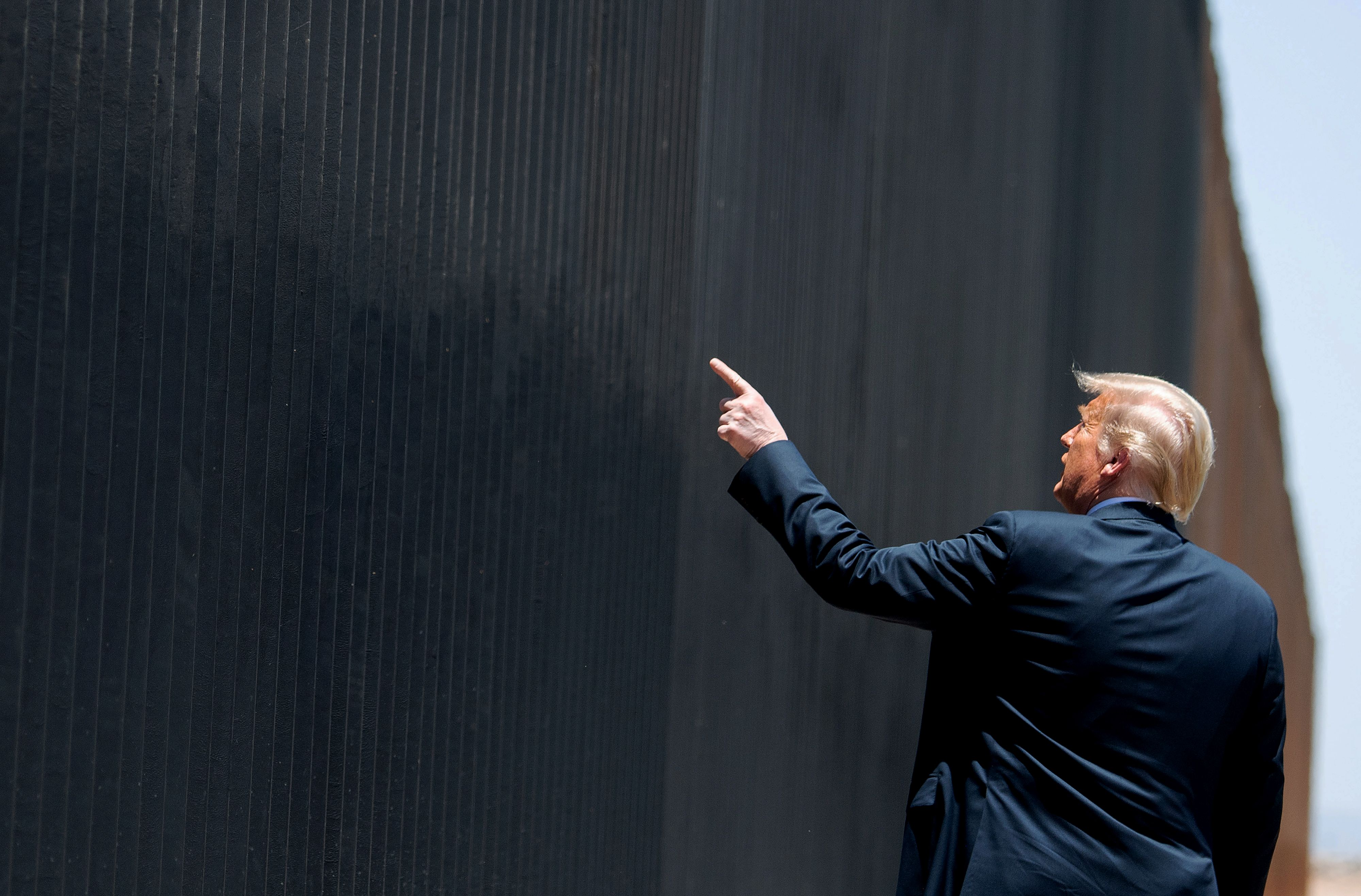 US President Donald Trump participates in a ceremony commemorating the 200th mile of border wall at the international border with Mexico in San Luis, Arizona, June 23, 2020. (Photo by SAUL LOEB / AFP) (Photo by SAUL LOEB/AFP via Getty Images)