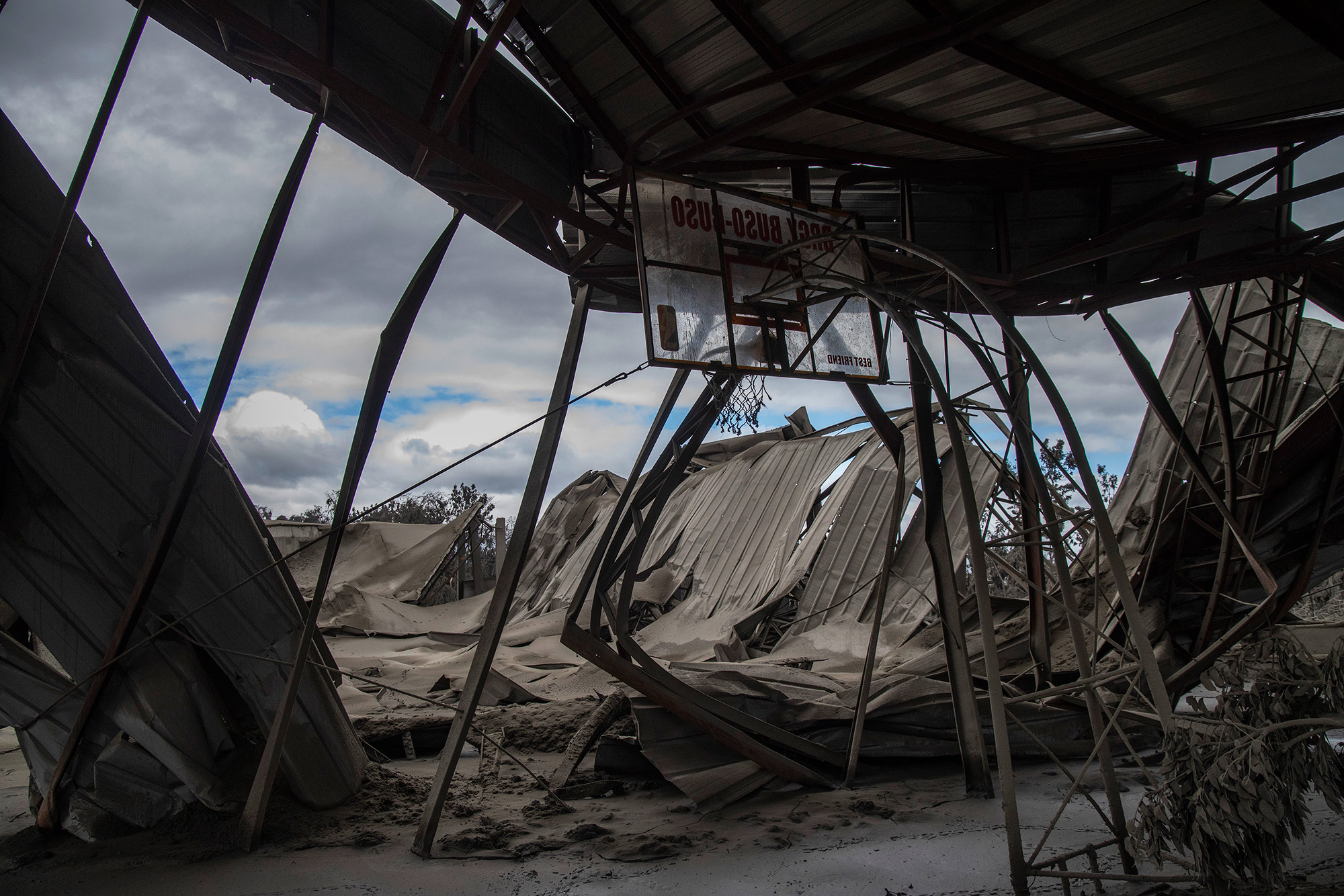 LAUREL, PHILIPPINES - JANUARY 14: The roof a basketball gymnasium, destroyed by volcanic ash from Taal Volcano's eruption, is seen on January 14, 2020 in Laurel, Batangas province, Philippines. The Philippine Institute of Volcanology and Seismology raised the alert level to four out of five, warning that a hazardous eruption could take place anytime, as authorities have evacuated tens of thousands of people from the area. An estimated $10 million worth of crops and livestock have been damaged by the on-going eruption, according to the country's agriculture department. (Photo by Ezra Acayan/Getty Images)
