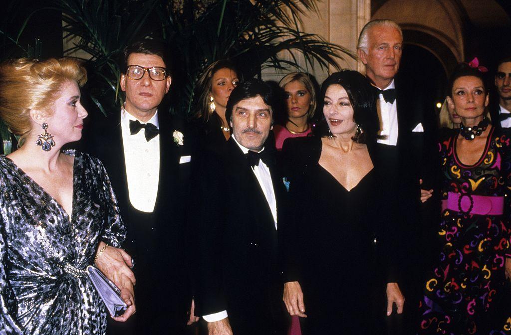 atherine Deneuve, Yves Siant Laurent, Emmanuel Ungaro, Anouk Aimee, and Hubert de Givenchy attend a party 1990 in Paris, France.КРЕДИТ