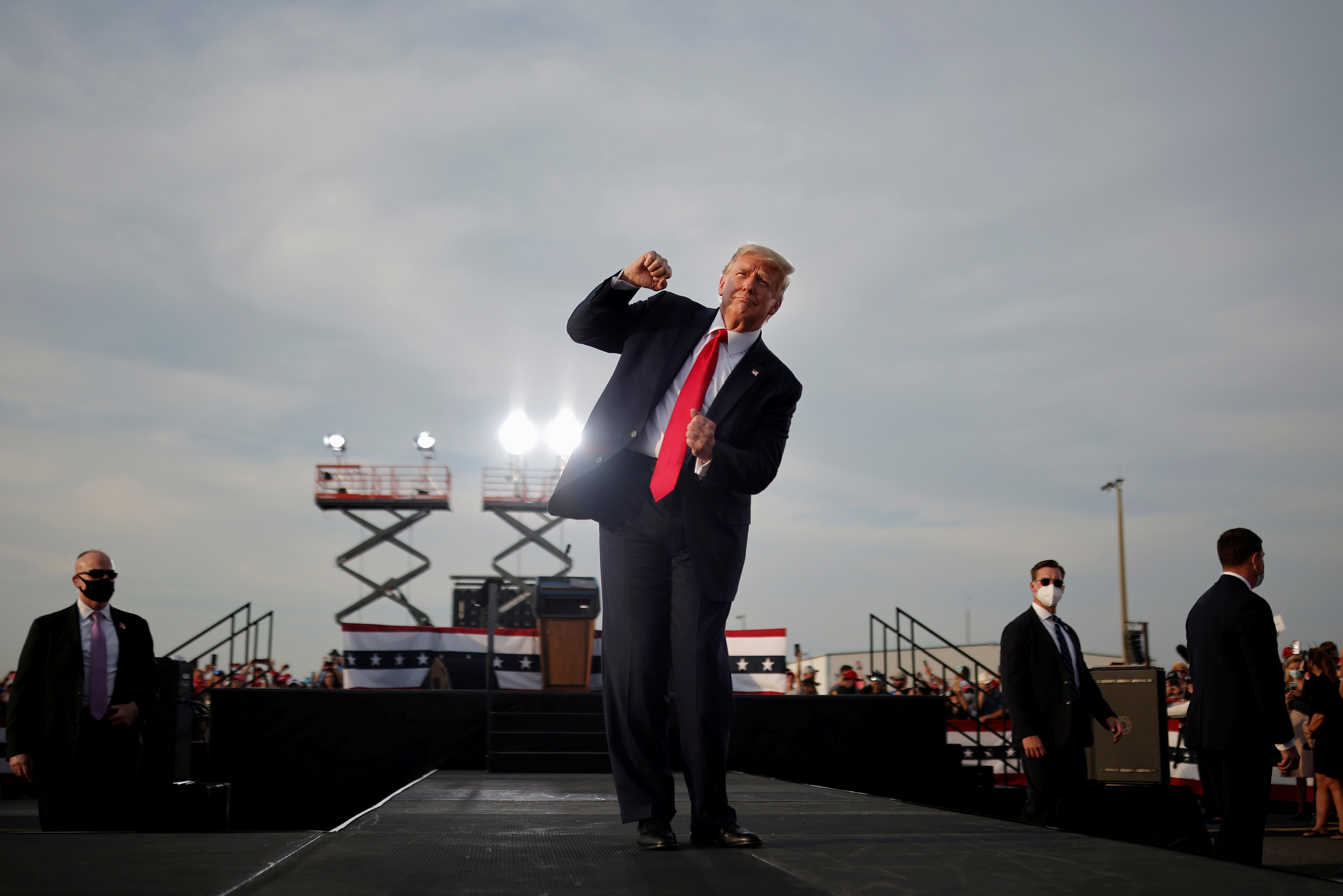U.S. President Donald Trump reacts at the end of his campaign rally at Ocala International Airport in Ocala, Florida, U.S., October 16, 2020. Carlos Barria: