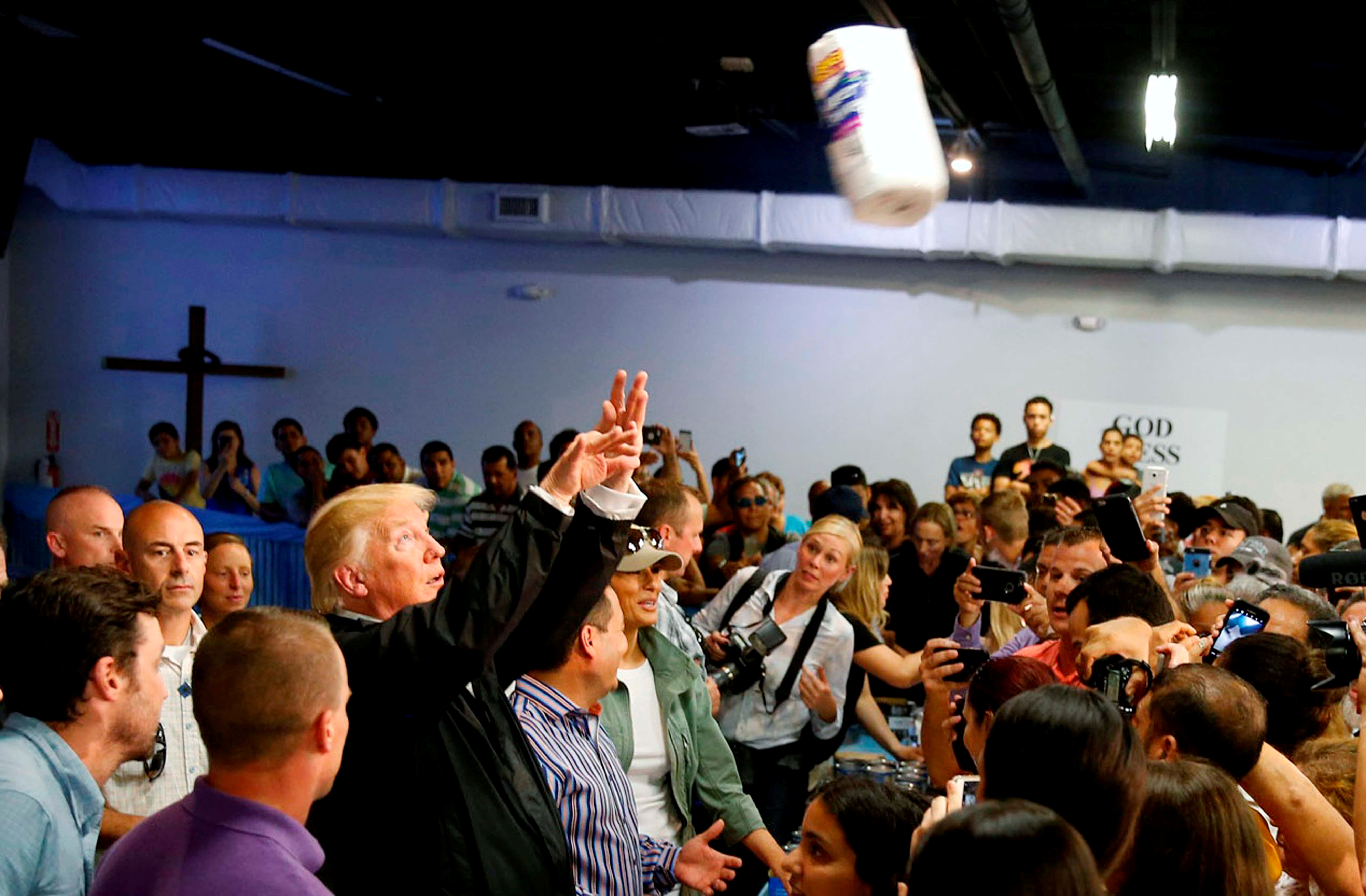U.S. President Donald Trump throws rolls of paper towels into a crowd of local residents affected by Hurricane Maria as he visits Calgary Chapel in San Juan, Puerto Rico, U.S., October 3, 2017. Jonathan Ernst: