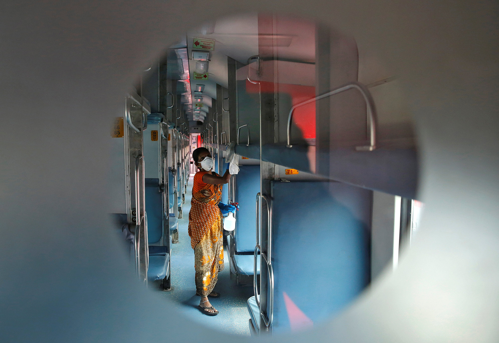 A worker disinfects the interiors of a passenger train parked at a railway yard as a preventive measure against coronavirus, on the outskirts of Kolkata, India, March 16, 2020. REUTERS/Rupak De Chowdhuri