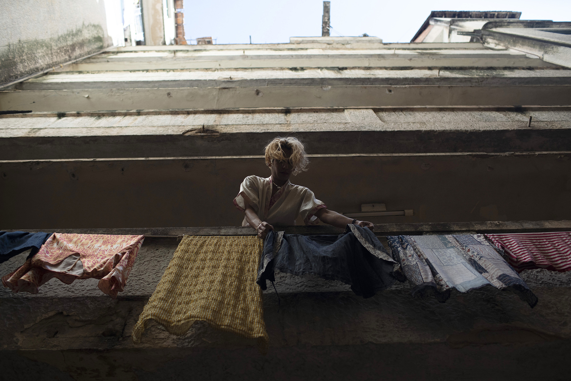 мTransgender Alex hangs clothes out to dry at the squat known as Casa Nem in Rio de Janeiro, Brazil, Wednesday, July 8, 2020. In 2016, members of the LGBTQ community led by Indianara Siqueira took over the balconied building with small bedrooms, shared bathrooms and a big common kitchen