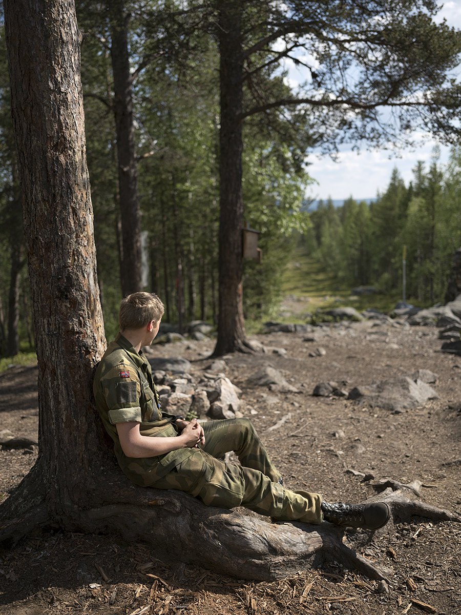 A Norwegian conscript takes a break while watching the Russian/Finnish/Norwegian border, at Treriksrøysa three-border zone