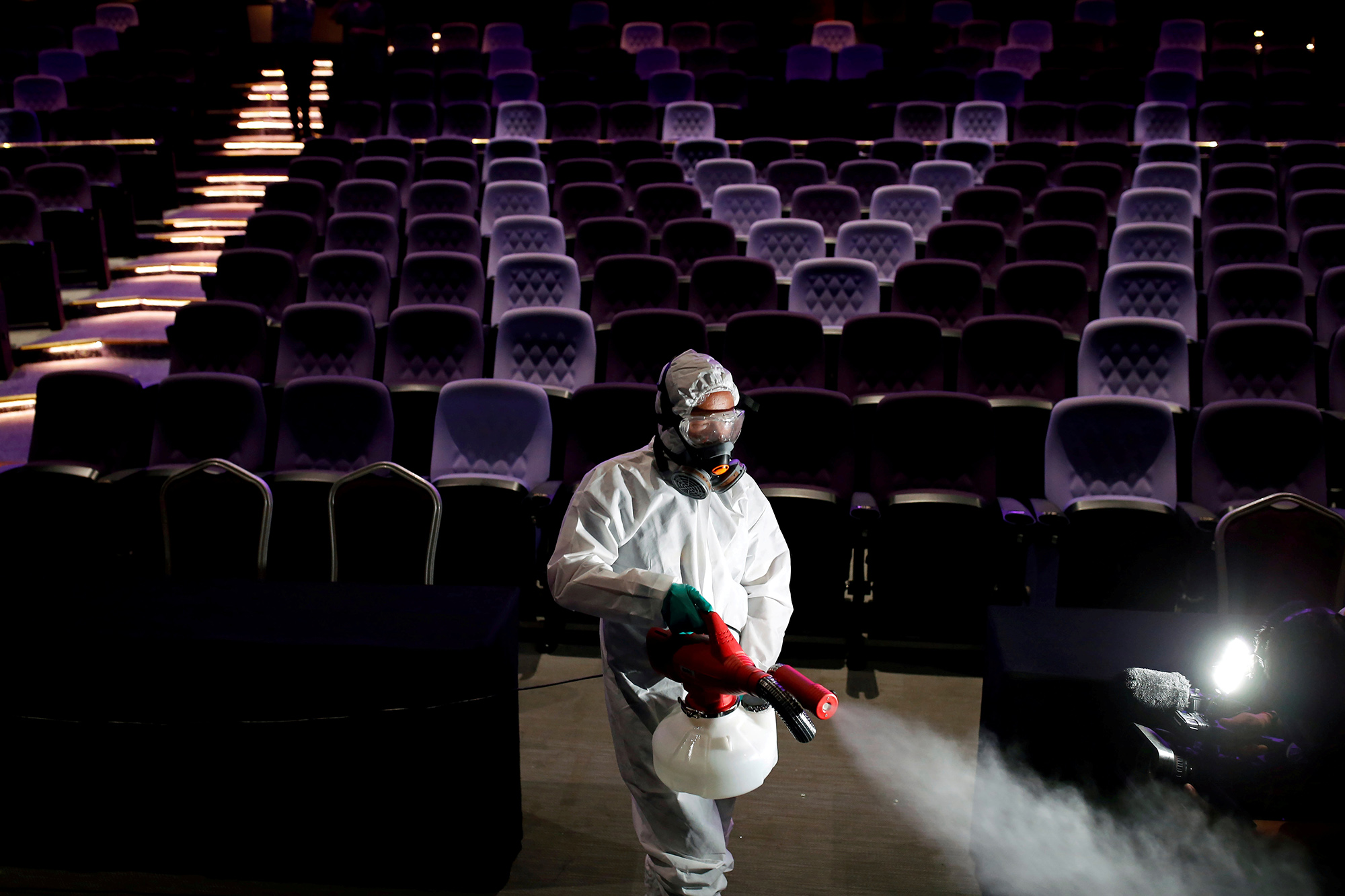 DATE IMPORTED:March 06, 2020A worker sprays disinfectant inside the theatre before the Miss International Queen beauty pageant for transgender women in Pattaya, Thailand March 7, 2020. REUTERS/Soe Zeya Tun TPX IMAGES OF THE DAY