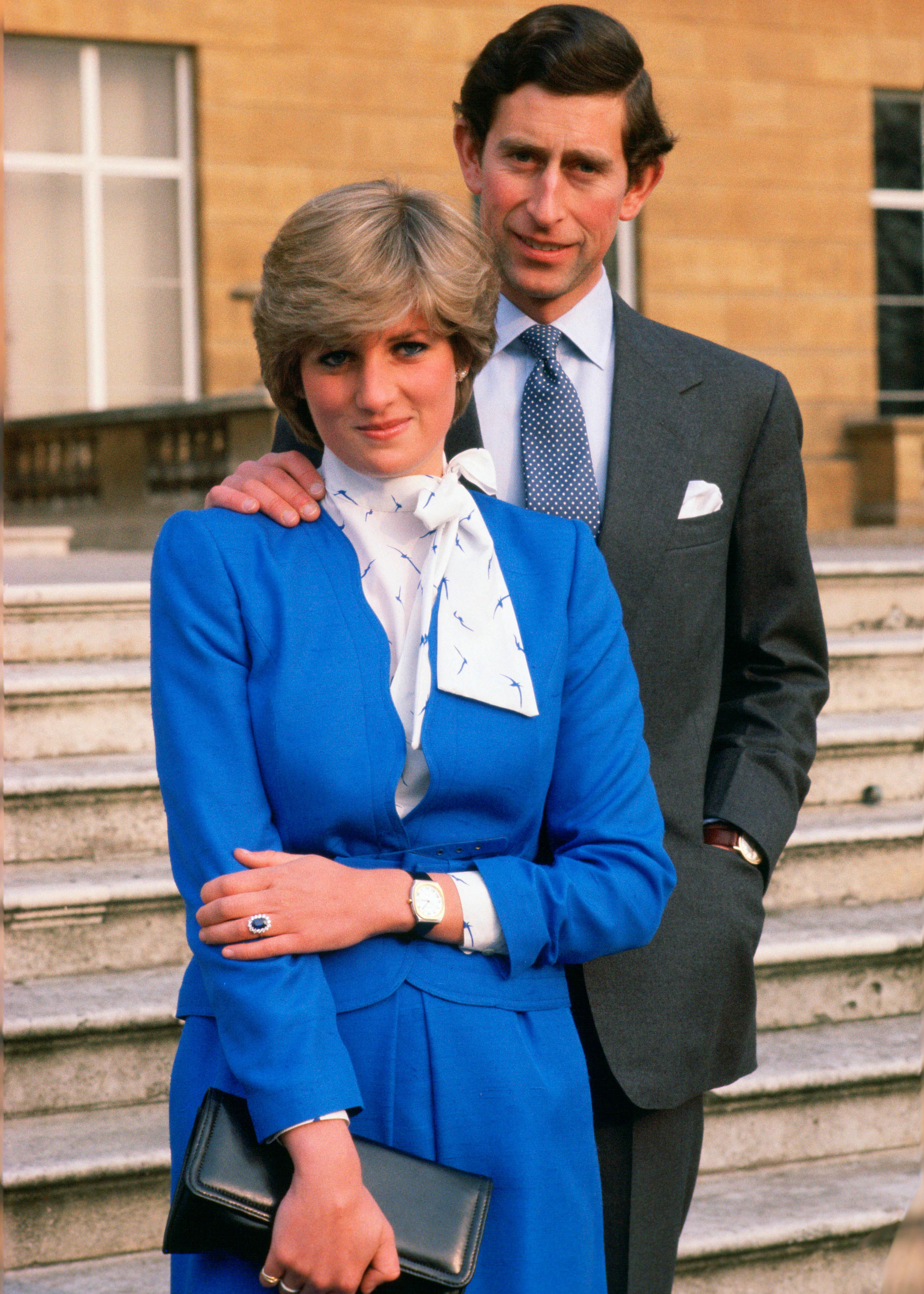 GREAT BRITAIN - FEBRUARY 24: Lady Diana Spencer (later to become Princess of Wales) reveals her sapphire and diamond engagement ring while she and Prince Charles, Prince of Wales pose for photographs in the grounds of Buckingham Palace following the announcement of their engagement 1981