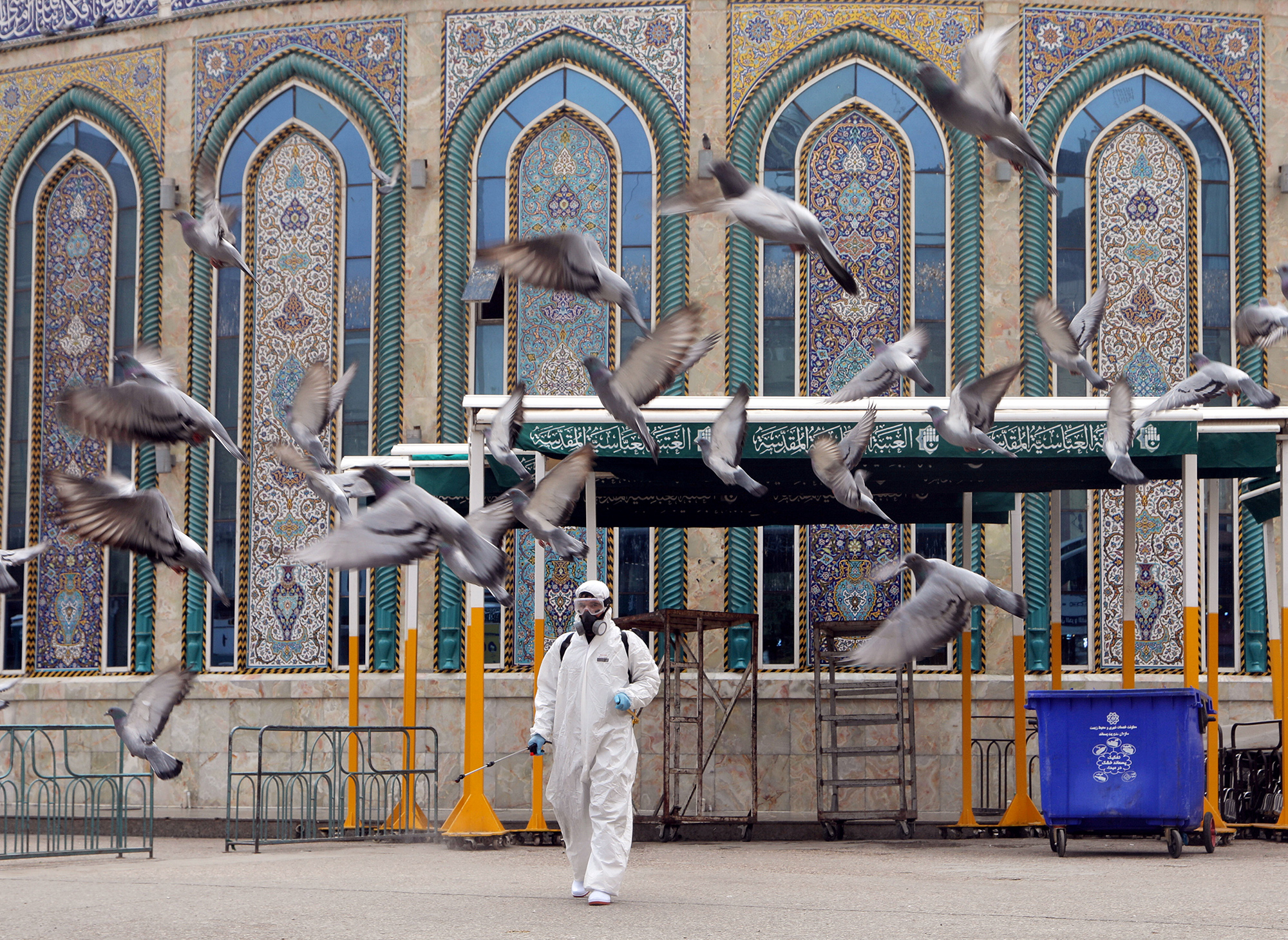 DATE IMPORTED:March 15, 2020A worker in a protective suit sprays disinfectants near Imam Abbas shrine as a precaution against the coronavirus, following the outbreak, in the holy city of Kerbala, Iraq March 15, 2020.REUTERS/Abdullah Dhiaa Al-deen TPX IMAGES OF THE DAY