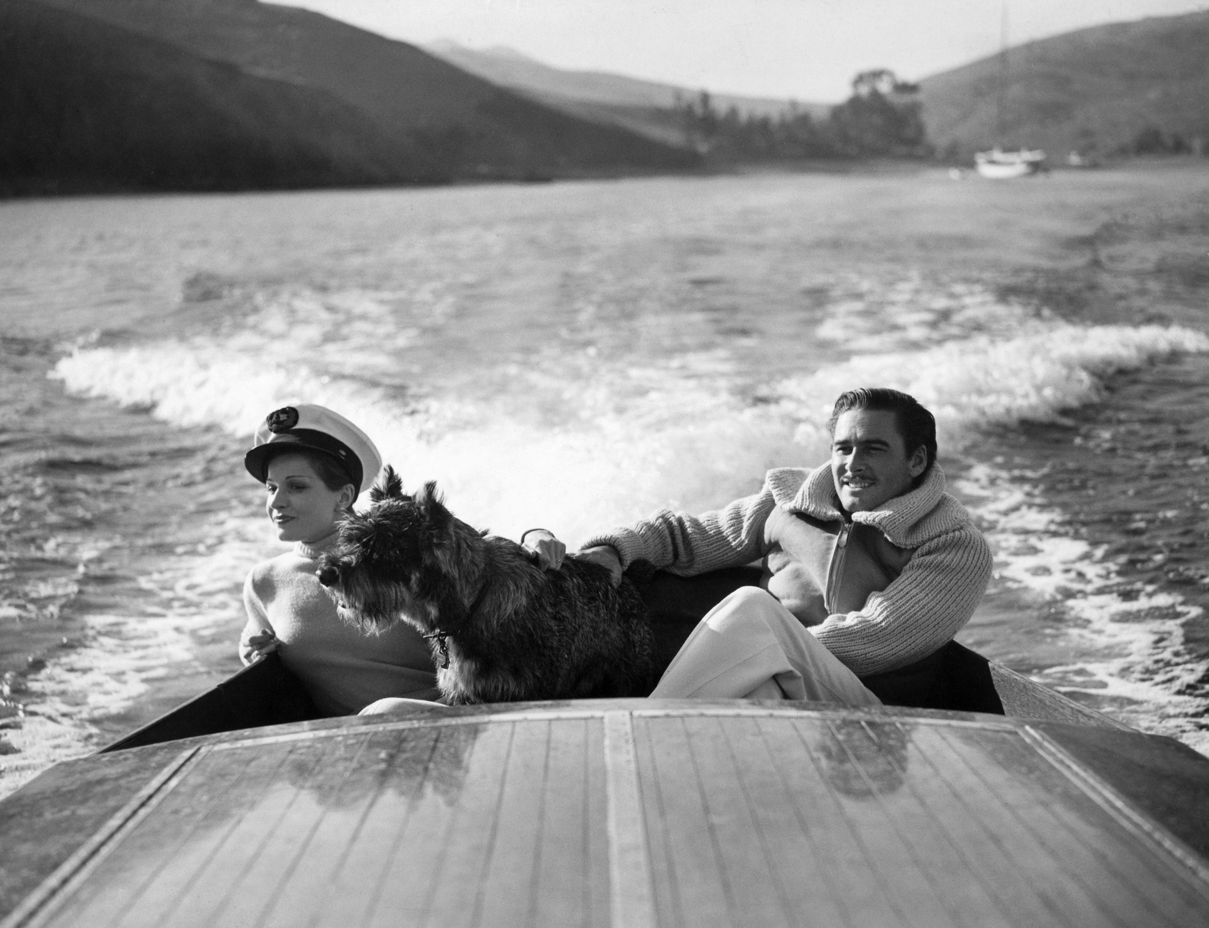 Errol Flynn and Lily Damita Boating(Original Caption) Errol Flynn and his first wife, the French film star Lily Damita. (Photo by