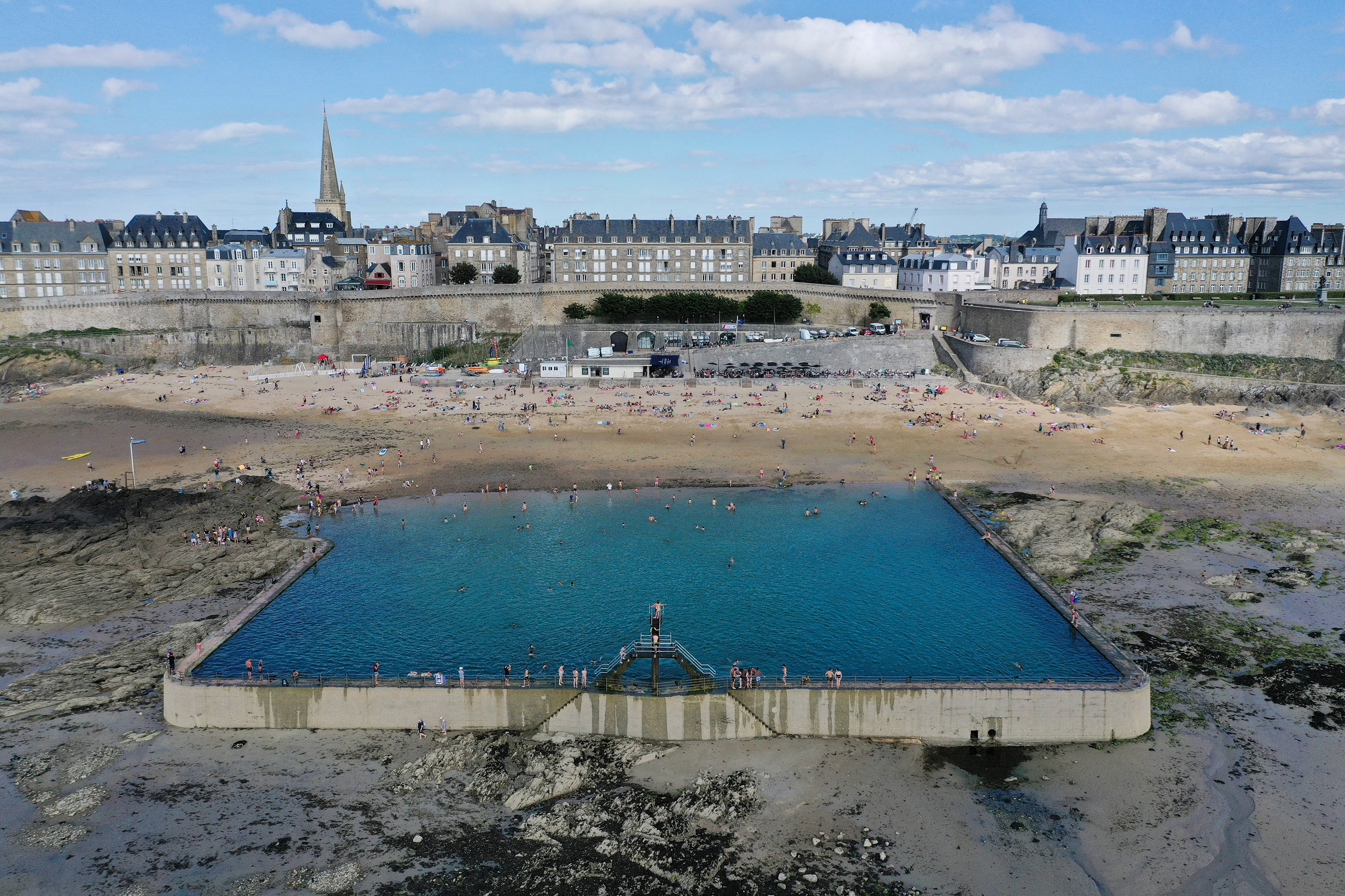An aerial photograph taken on July 9, 2020 shows people enjoying a seawater pool on the beach of Saint-Malo, western France.