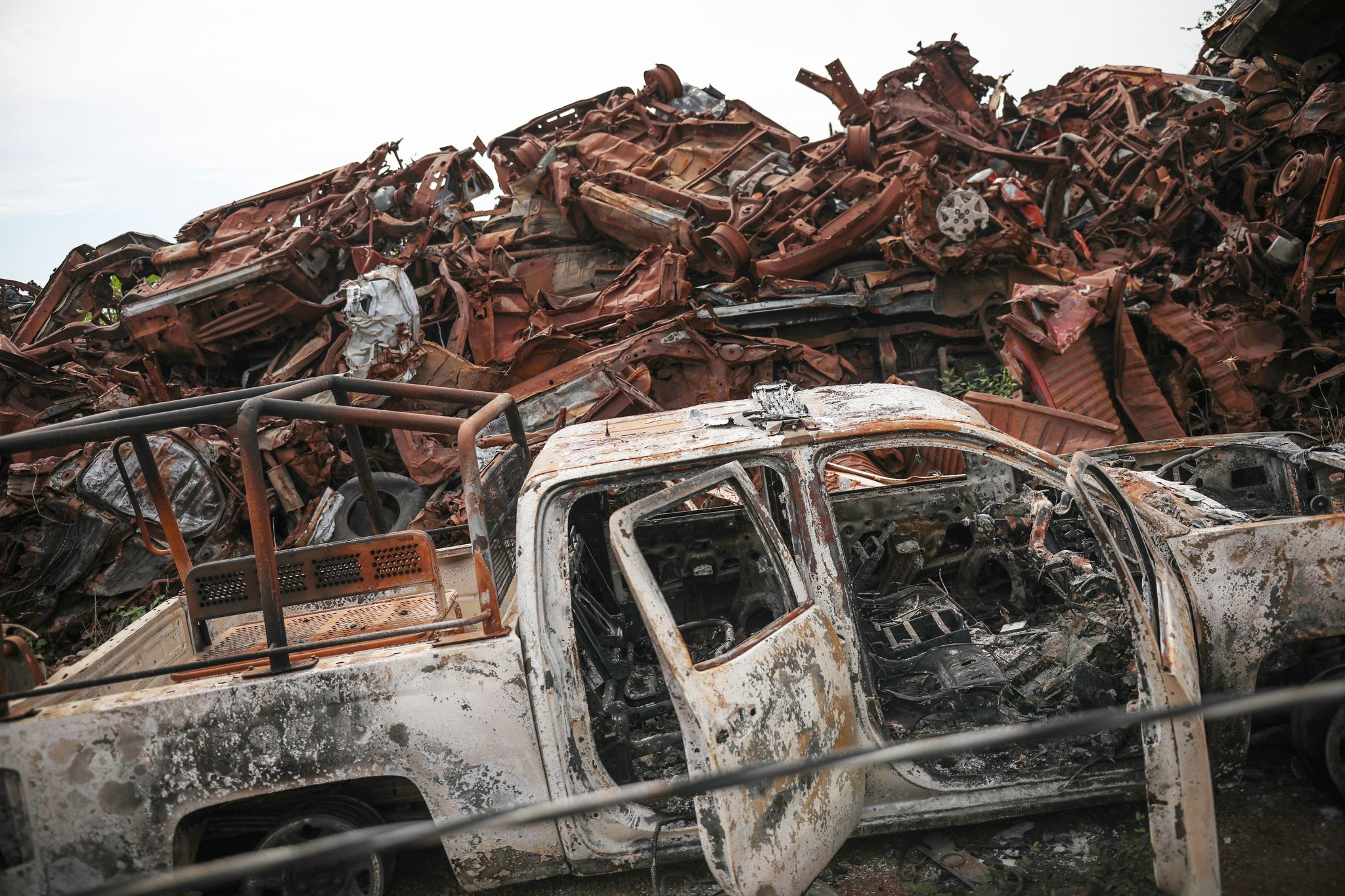 A junkyard littered with the husks of vehicles that were set on fire by sicarios during the Black Thursday attack