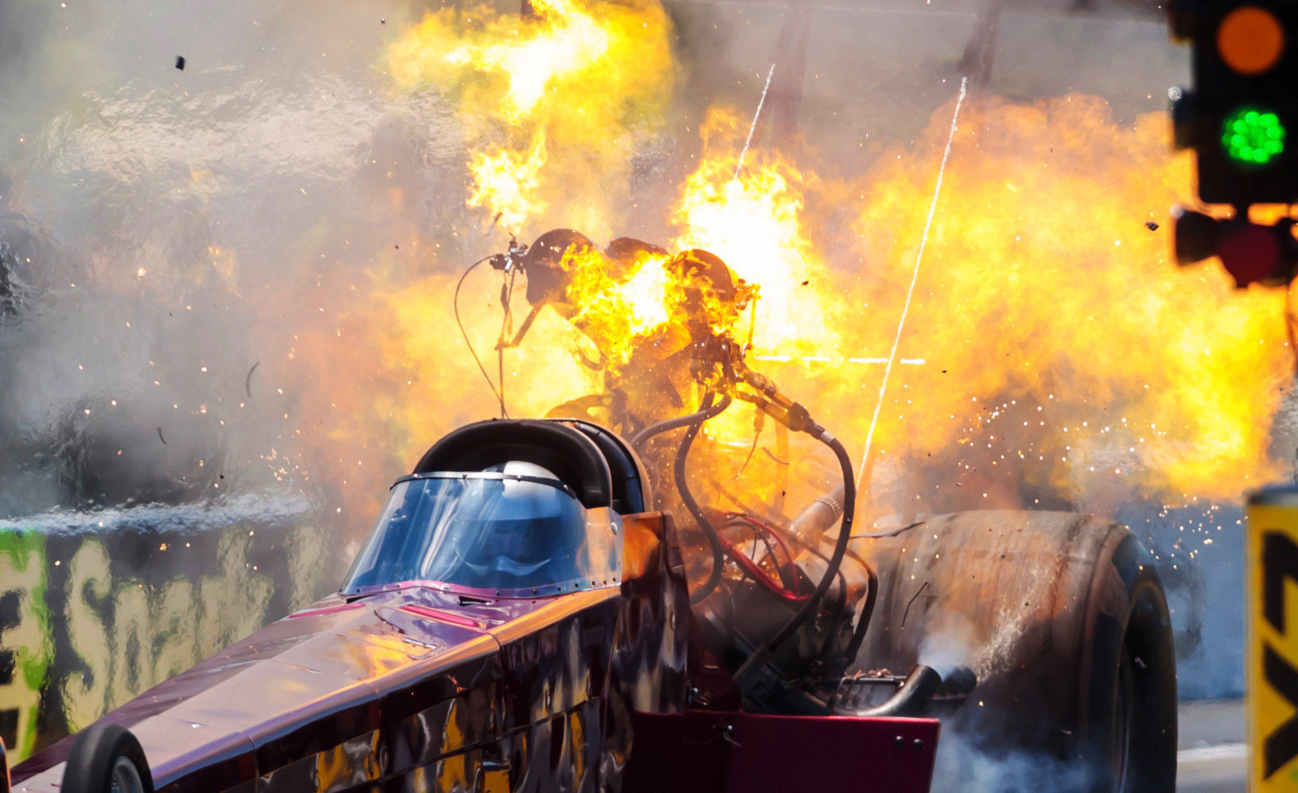NHRA top fuel driver Kyle Wurtzel explodes an engine on fire during qualifying for the E3 Spark Plugs Nationals at Lucas Oil Raceway. This is the first race back for NHRA since the start of the COVID-19 global pandemic.