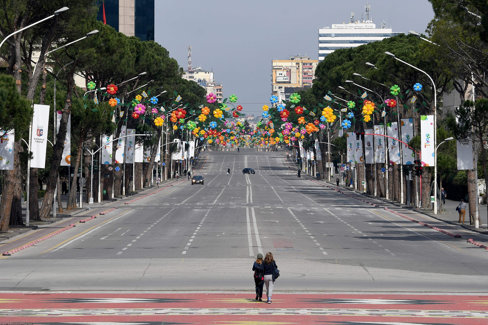 A picture taken on March 14, 2020, shows the empty main Boulevard of Tirana, amid the outbreak of COVID-19, the new coronavirus. - Albania has stepped up measures to contain the spread of COVID 19 and banned circulation of all cars (except ambulances and supplies) for three days and urged people to stay home as the number of infected people increased to 38. (Photo by Gent SHKULLAKU / AFP)