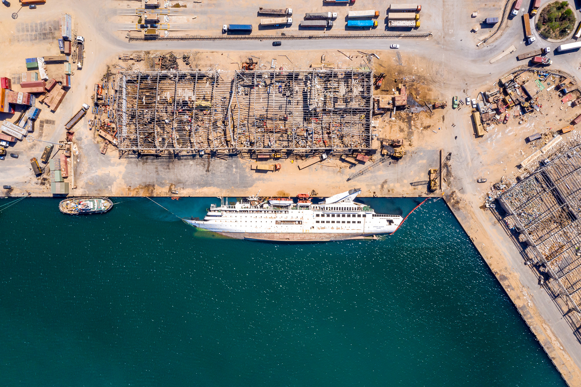 BEIRUT, LEBANON - AUGUST 21: An aerial view of a capsized cruise ship, damaged in the Beirut Port blast, on August 21, 2020 in Beirut, Lebanon. The explosion at Beirut's port killed over 200 people, injured thousands, and upended countless lives. There has been little visible support from government agencies to help residents clear debris and help the displaced. As residents continue to clean up after the Beirut port explosion, Lebanon has issued a two week lockdown starting August 21 after Coronavirus cases surged in the aftermath of the explosion. (Photo by Haytham Al Achkar/Getty Images)