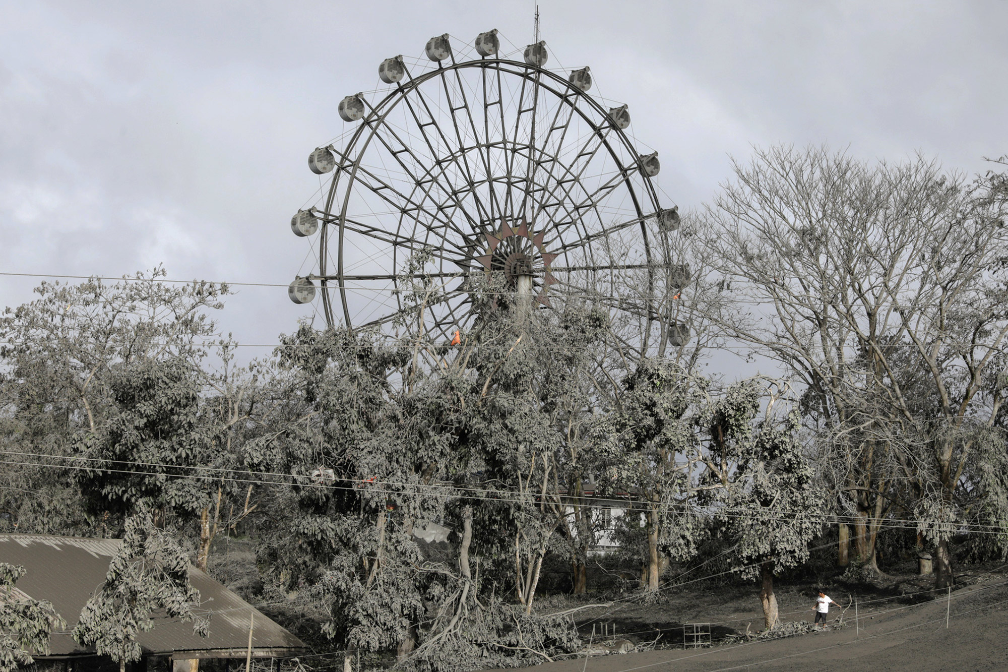 A ferris wheel is covered with volcanic ash in a park in Tagaytay City, Philippines, January 14, 2020. REUTERS/Eloisa Lopez