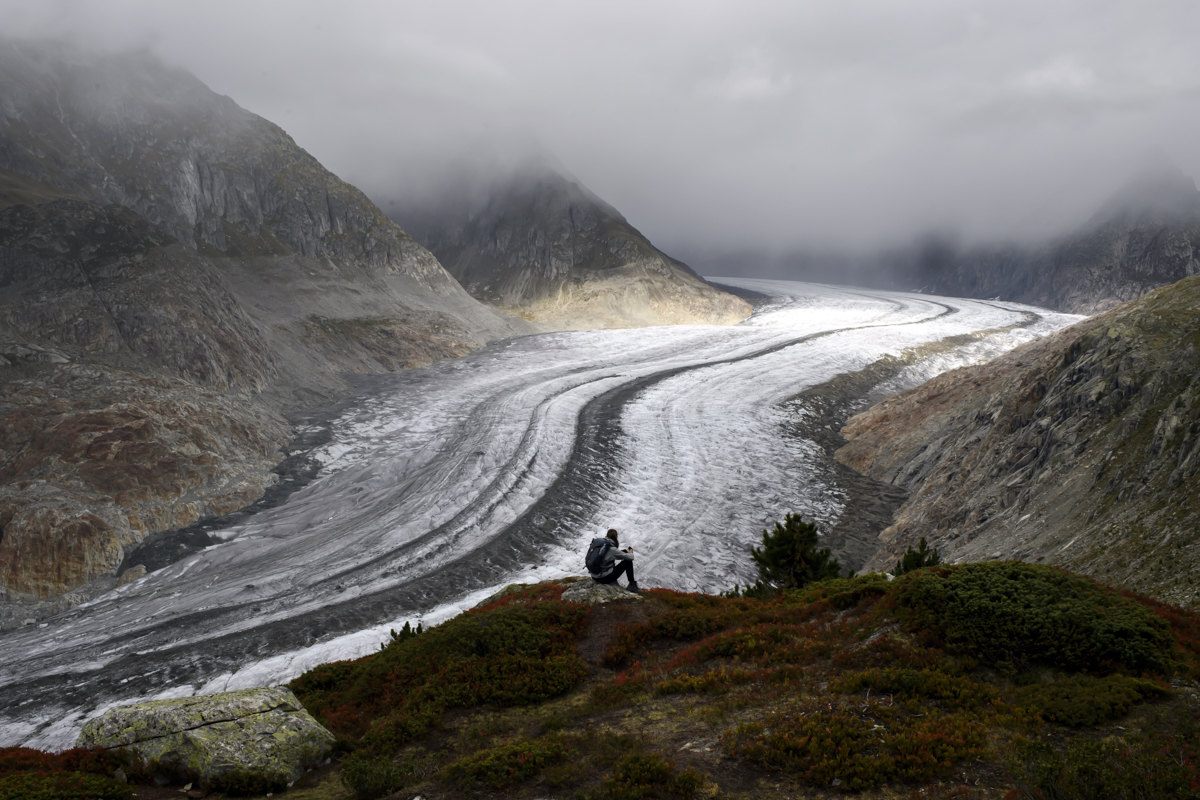 Stefanie enjoys the view of the Swiss Aletsch Glacier, in Valais, Switzerland, 25 September 2019 (issued 26 September 2019). The Swiss Aletsch glacier, one of the largest ice streams in Europe, is the first Unesco World Heritage Site of the Alps. This huge river of ice stretches over 23 km from its formation in the Jungfrau region (at 4000 m) down to the Massa Gorge in Valais, around 2500 m below.