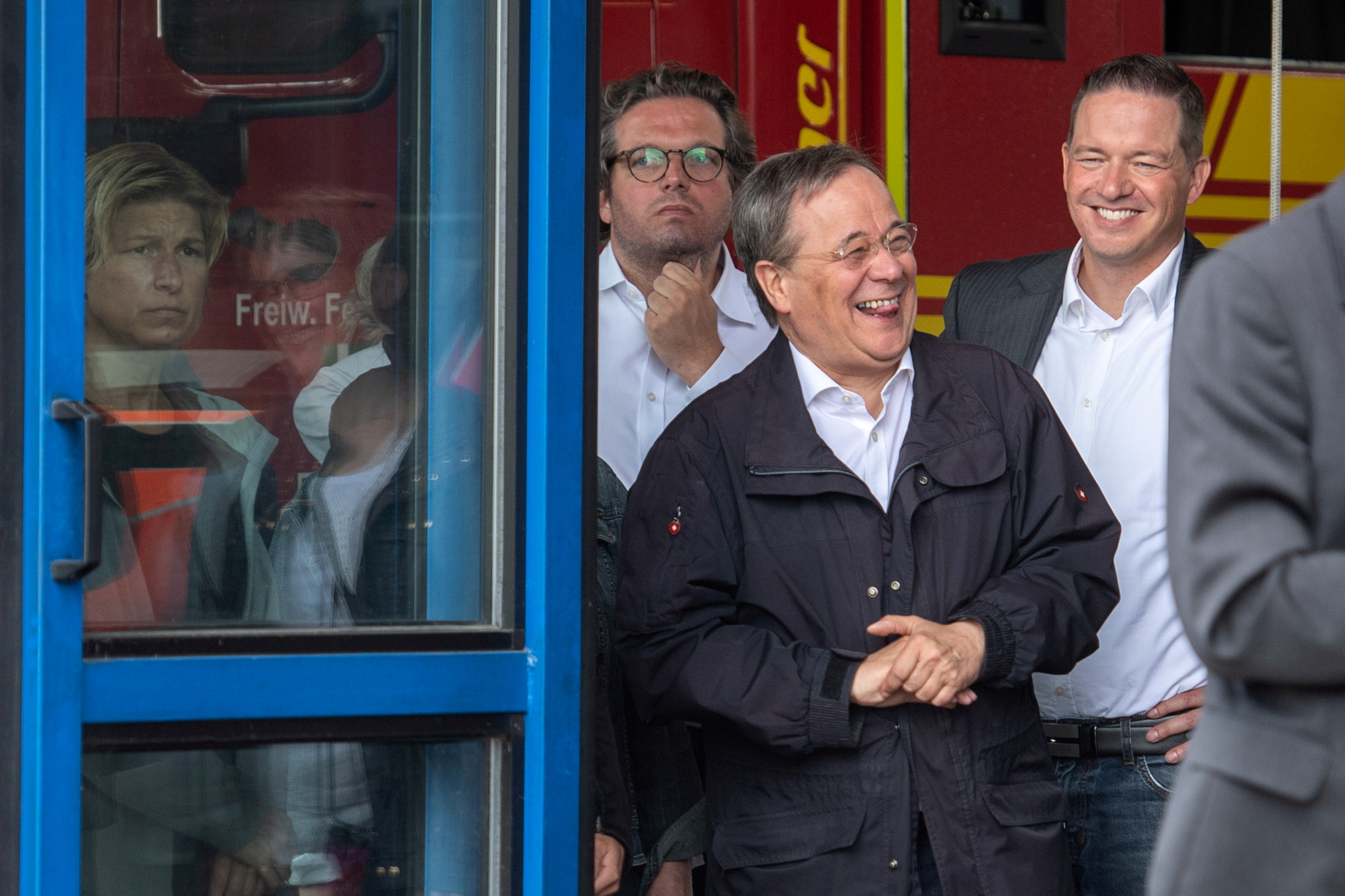 DOCUMENT DATE:July 18, 2021CDU leader and North Rhine-Westphalia's State Premier Armin Laschet laughs as the German president (unseen) delivers a speech during their visit to flood-hit Erftstadt, Germany July 17, 2021. Picture taken July 17, 2021 Marius Becker/Pool via REUTERS