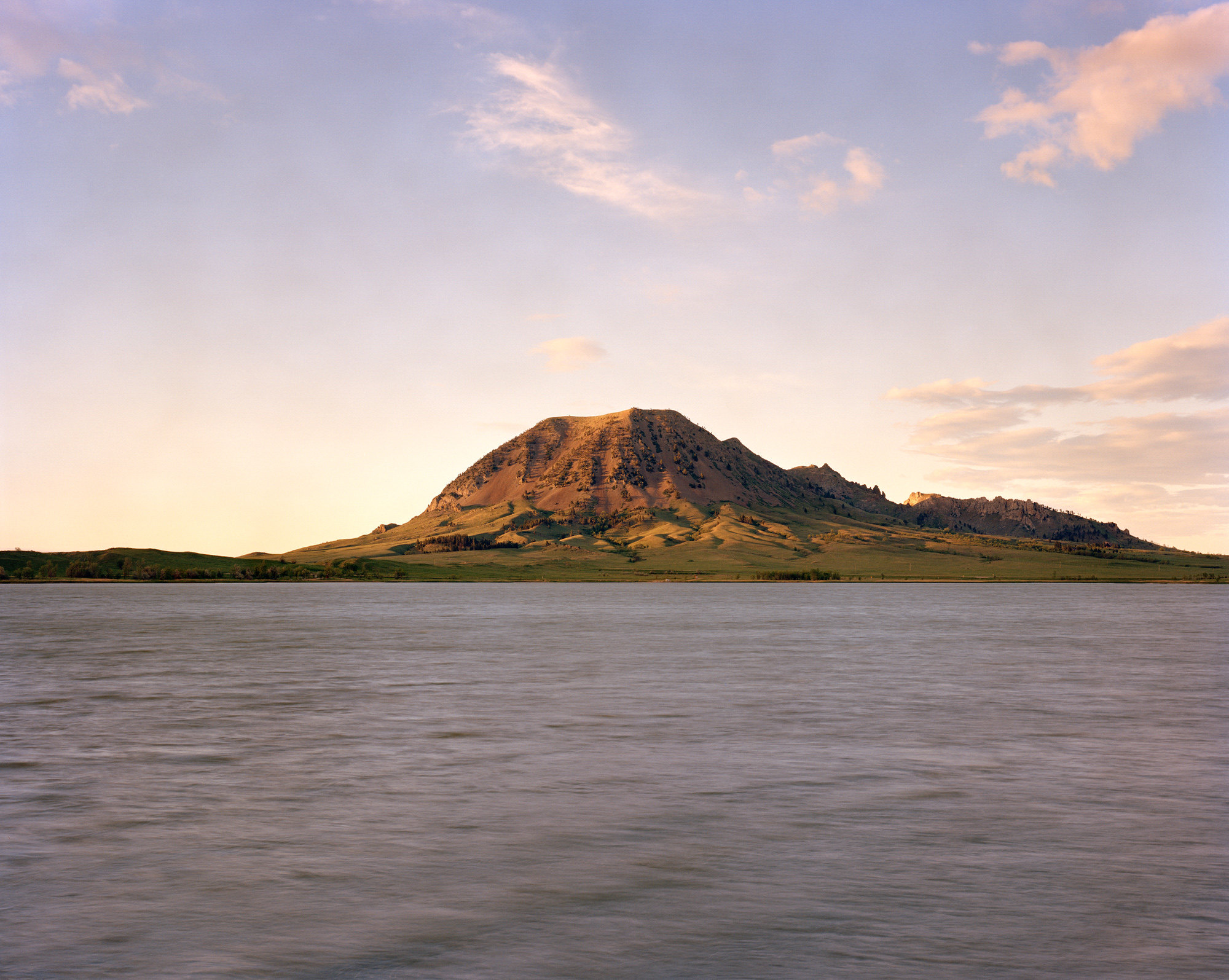 """Matò Pahà, Bear Butte State Park, Meade County, SDThe sacred mountain of Bear Butte in South Dakota is a holy site for many American Indian tribes. The Lakota people call itMatò Pahàor """"Bear Mountain,"""" a reference to the fact that its profile resembles a sleeping bear. Revered leaders like Red Cloud, Crazy Horse, and Sitting Bull all visited this mountain to pray, and it continues to be a place of pilgrimage for Indians throughout the United States and Canada. Vision quests, sweat lodges, and other ceremonies are frequently held on the mountain."""