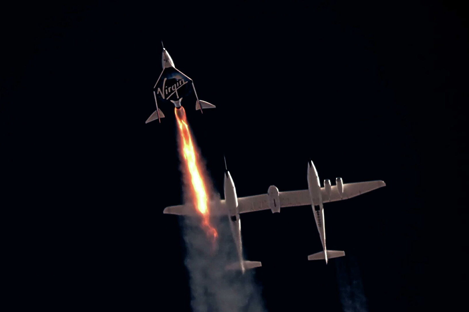 Virgin Galactic's passenger rocket plane VSS Unity, carrying Richard Branson and crew, begins its ascent to the edge of space above Spaceport America near Truth or Consequences, New Mexico, U.S. July 11, 2021 in a still image from video.