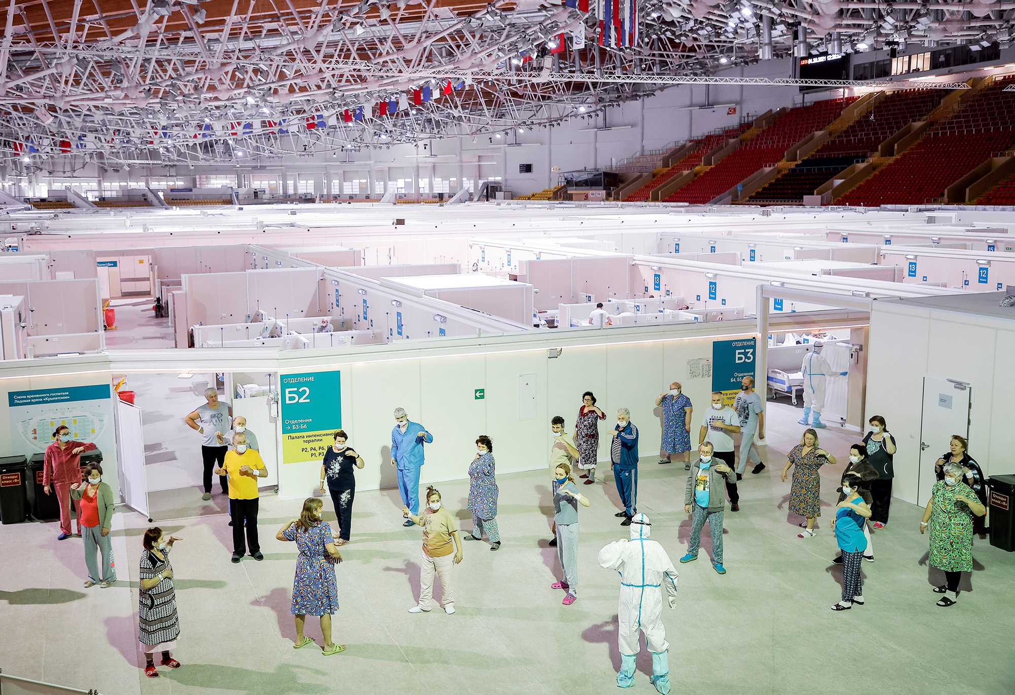 Patients follow instructions while practicing Tai Chi at the Krylatskoye Ice Palace, which was converted into a temporary hospital for people suffering from the coronavirus disease (COVID-19), in Moscow, Russia, January 20, 2021. Picture taken January 20, 2021. REUTERS/Maxim Shemetov