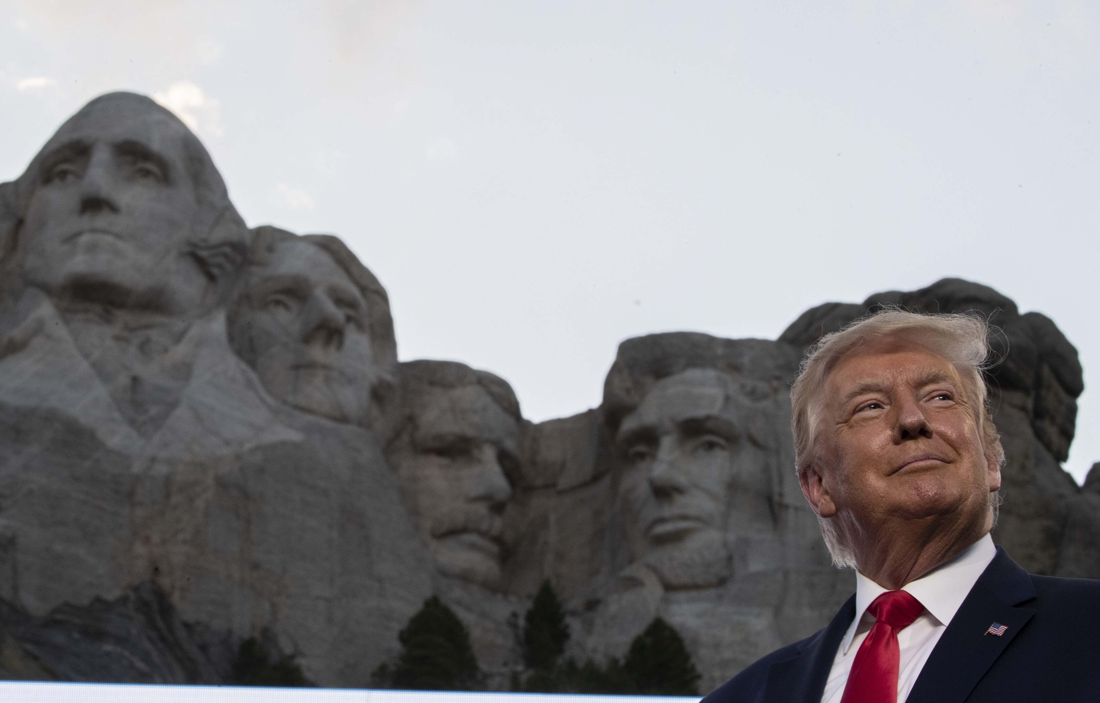 President Donald Trump smiles at Mount Rushmore National Memorial