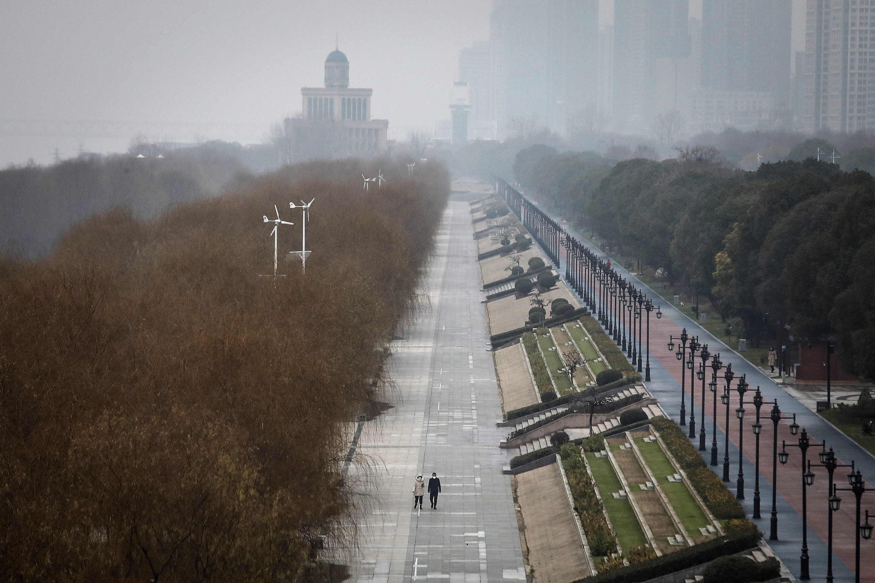 WUHAN, CHINA - JANUARY 27: (CHINA-OUT) Two residents walk in an empty Jiangtan park on January 27, 2020 in Wuhan, China. As the death toll from the coronavirus reaches 80 in China with over 2700 confirmed cases, the city remains on lockdown for a fourth day. (Photo by Getty Images)